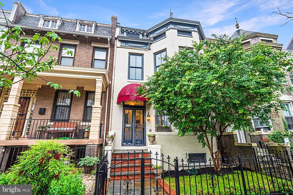 ***2 unit building *** From the moment one steps through the intricate wrought iron gates onto the front garden, 132 U Street NW, with its inviting painted brick facade and bay windows, has all of the charm expected of a classic Bloomingdale Victorian - with every modern amenity. A thoughtfully laid out floor plan comprises contemporary finishes and is enhanced by rustic Heart of Pine hardwood flooring throughout an abundance of natural light, allowing for comfortable 21st-century living wrapped up in a timeless and elegant package. The generously proportioned formal living room contains one of three gas fireplaces and flows seamlessly into a vestibule with access to either the unique side courtyard or the owner's suite upstairs. Further along, the main corridor is a flexible home office that can be used as a main level guest bedroom, with its own adjacent full bath boasting a glass-enclosed shower and contemporary tile work. The formal dining room is amply sized and fully open to a gourmet kitchen with a large center island, bar seating, modern cabinets, and professional-grade appliances. Sliding glass doors bring the outside in, allowing for direct access to the screened-in porch. A laundry room with outdoor access completes the main level. Upstairs is where this home becomes unique, providing an unobtrusive income-generating opportunity and unparalleled flexibility. The front third of the upper level contains a spacious primary suite with its own gas fireplace, walk-in closet, and ensuite bath. The remaining two-thirds of the upper level is dedicated to a self-sufficient one-bedroom unit with a full bath, living room, kitchen, and even a possible studio overlooking the rear patio. Outside, a private outdoor entertaining area doubles as a parking pad, with a secure, roll-up garage door leading to ample parking for two cars. The rear of the home also provides access to the basement, a fully insulated storage area enhancing the already abundant storage space within 