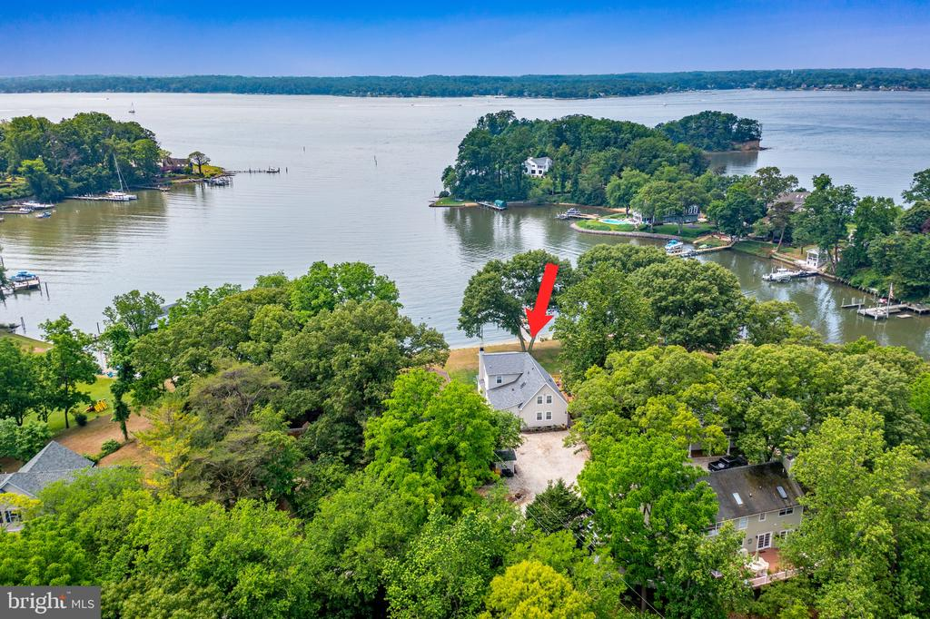 Move in ready and located on a quiet cul-de-sac in the desirable North Shore on the Magothy. Huge deep water pier offers 6 feet MLW and multiple slips including a 12,500 lb. boat lift, and Mini-Mag jet ski/Skiff lift. 2 shore power hook ups at dock supplying 240V to your boat or visiting friend's yachts Fresh water at dock and fish cleaning station Kayak rack. New Marine Grade pressure treated supports and decking boards in 2020. 113' feet of sandy beach frontage offers stunning water view. This totally renovated home with outstanding water views and expansive yard sits mid-point in the sheltered cove, deep watered Park Creek, on an over-sized lot and is just seconds to the river and minutes to the Chesapeake Bay. Boat to Dobbins Island in under 5 minutes or hang out on your own sandy beach with your family and friends! Great community with beach, marina, ramp and playground. 5 spacious Bedrooms and 3 ½ Bath. Two Primary Baths (1 roughed in for future 4th bath) and doubleWalk-in closets. Beautifully updated kitchen in 2021. This 1986 home (now 4,375 sq feet of finished space) is newly and totally renovated with additional square footage added in May 2018, including all new roof with life-time warranty, maintenance free siding with life-time warranty, custom exterior windows and doors with life-time warranty, new composite decking and exquisite cable railing with cedar posts, new Aquaklear (BAT) septic and state-of-the-art well water filtration and conditioning. New garage with high ceilings and cantilevered storage and large detached shed, spacious 8-car parking in front! New heat pump and AC units in 2016 and 2018. Wood burning fireplace, hardwood floors, walkout basement with great water views and Guest suite to include designer bathroom with marble and granite. Inside you will find an open floorplan perfect for grand entertaining. The designer Kitchen features gorgeous custom granite countertops, Italian tile backsplash, and a large island with plenty of cabinet 