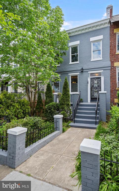 Here is a rare opportunity to purchase a classic federal style townhouse in Bloomingdale, a vibrant community that's one of DC's most coveted addresses. The Bloomingdale Historic District received its official designation in 2018, and has earned its popularity organically. Channing Street is known for the largest, 2,850sq/f of the lots, offering endless opportunity for a savvy buyer to use this blossoming rose garden to entertain a large group of people, kids, dogs, or even build an additional structure (check neighboring comps), and still be getting a great bargain. At the backend of the yard you'll own a private parking spots for two cars, which is priceless in DC. This home features some of increasingly rare original antique decorative details. Care was taken to retain the hand forged door hardware. The original floor plan is still fairly intact. A welcoming entrance foyer and hallway opens into a gracious receiving area or living room that includes a fireplace, beautifully decorated with hand made tiles. Separate dining room, huge updated windows, soaring more than 10' ceiling, updated HVAC, and 5years old roof makes this home wonderfully livable with fun, and style. Kitchen with a modern touch like granite countertop, stainless steel appliances leads into a sunroom extension which can be used as a home office, art studio, or a sitting area. Three bedrooms on the upper level have old growth hardwood floors, a material that is no longer commercially available. Relax in a jet tub in an upstairs tiled bathroom. Finished basement has an updated full bath, and an outside entrance. Enjoy the pulse of the city with a short drive to restaurants, vibrant nightlife, thriving Farmer's markets before returning home to the suburban feel of your historic neighborhood across the road of planned McMillan Development (check here development presentation https://vimeo.com/75443595, https://www.envisionmcmillan.com/vision/ ). Within a close proximity of Union Station, Children's H