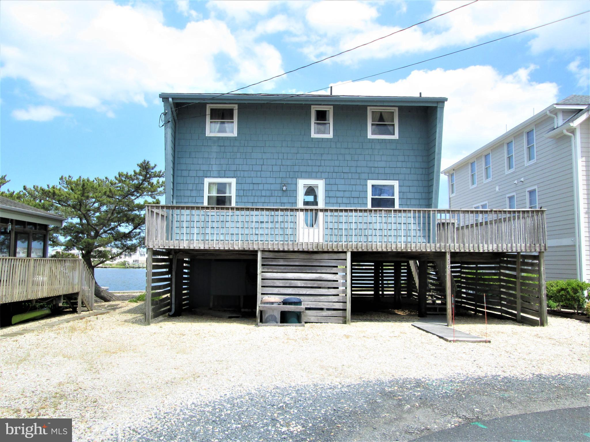 """Hard to find bay front property in the heart of Fenwick Island.  Wonderfully located on the open water on a non thru street, very quiet area.  Crab or fish right off the bulkhead in the back yard. The property itself is ready for your boat dock or even better your private boat lift.  Traffic light at the street end allows for simple and safe crossing of the highway while making your way to the lifeguarded beach. Home is easy to show. This property is being sold """"as is."""""""