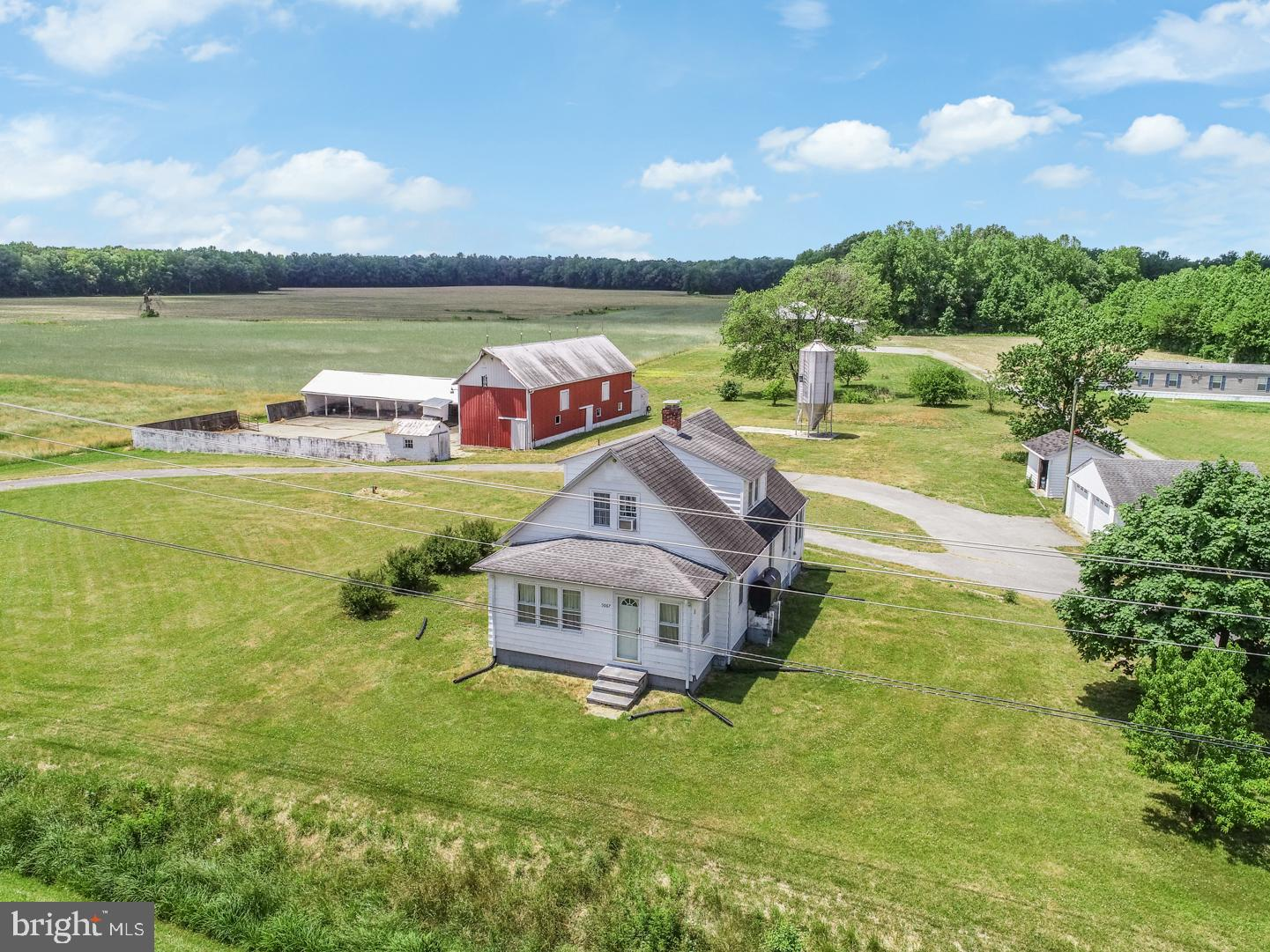 Welcome to the farm! Here, at 5067 Hopkins Cemetery Rd, you can appreciate all the wonders of nature and the freedom of wide open spaces.  This 16.88 acre farm includes a 3 bedroom, 2 bath home, detached 2 car garage, large cattle barn with extensions and 90' x 65 ' concrete stock yard,  90' by 50' pole building for large farm equipment storage, small grain silo, tool shed and over 10 -12 acres of open fields for cultivation. There is electrical power in the cattle barn, large pole building and garage. Until this year, fields have been leased and cultivated with regular crop rotations of corn, soybean, barley, sorghum, etc.  The house sits up on the hill at the front of the property and provides for a scenic overview of the land and structures.  Many recent improvements have made this a charming, farmhouse.  The country kitchen is virtually new from floor to ceiling. The  refrigerator, dishwasher and microwave/convention oven were recently replaced and the kitchen is a dream to cook in, with plenty of counter space for the many cooks in the house and enough storage for all the pots, pans and gadgets any gourmet chef could ever desire. For the technology proficient, the house has high speed internet access - great for the home office or remote learning. Other improvements include upgraded electrical service, new AC unit & air handler, blown-in insulation in the attic and insulation panels in storage eaves,  double lined chimney flue to accommodate the wood stove, and a new deep well (325') and pump for a clean refreshing water supply.  When you explore the grounds you will find many different fruit trees and bushes as well as an asparagus bed to enjoy. In the evening, relax by the fire pit and indulge in some s'mores and take in the beauty of  the evening sky - watch shooting stars cross the skies and observe the entire Milky Way!  So if you are ready to start your own farm or simply wish to enjoy the best of country living and have the land help you pay your bills, 