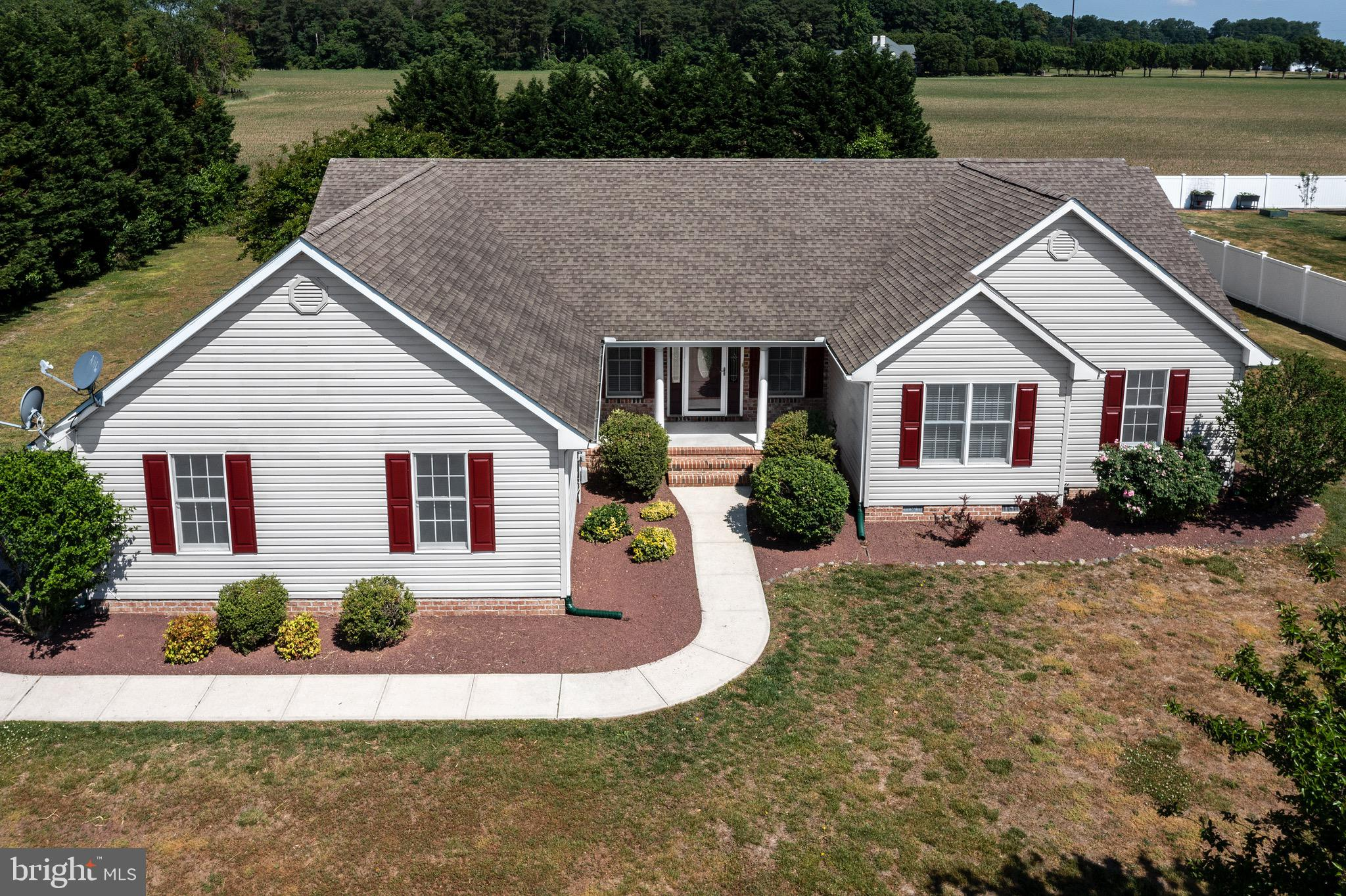 Custom built ranch home situated on a spacious 3/4 acre lot only 1 mile to the new Bayhealth Hospital! Enjoy the mature landscaping and outdoor private spaces to have a boat or RV to store or install an inground pool! Great property for enjoying outdoor entertainment and get togethers. There are no HOA fees to pay! Inside you will find a modern kitchen with open floor plan concept.  The split floor plan offers privacy from the guest bedroom. The owners suite offers a luxury bath with a huge walk-in closet with lots of natural light. Off the great room is a large 3 season room that can be enjoyed all year around. Open all the windows and its like having a screened in porch.  There is a patio off the 3 season room for BBQ and additional seating. If you are looking for storage, this home has pull down stairs to a huge storage room over the garage. The oversized 2 car garage is also ideal for additional storage or that workshop you have always wanted.  This home is move in ready along with fresh paint! The location is ideal just off coastal highway. You are a short ride to the Lewes and Rehoboth Beaches and also the Dover Air Force Base.
