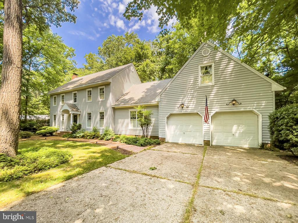 Timeless and classic, this custom-built home is situated on a TWO wooded lots in Ocean Pines.  (The current owner had them platted into one parcel).    Lovingly designed and meticulously cared for, you'll notice all of the attentions to detail as your tour this amazing home.    The exterior is highlighted by a well-manicured front yard, with an offset two-car garage.   The sides and back of the property feature a fenced in yard, (perfect for your furry-friends), along with an oversized back-deck that's ready for family BBQ's.    This home features a formal entry foyer with grand-staircase, hardwood floors throughout the first floor, two stunning wood-burning fireplaces, a formal dining room, family room, and 4-seasons Sunroom.   The country kitchen is the heart of this home, with upgraded appliances, a beautiful oversized island (with cooktop), and room for a kitchen table.     Also located on the first floor is a spacious owners-suite and private laundry room.   Upstairs you'll be pleased to find room for lots of family and friends to spread out.    Four spacious bedrooms, two full baths, plus a bonus storage-room over the garage!     We can confidently state that there's no other home like this in Ocean Pines!   You're going to want to see this before it's gone.