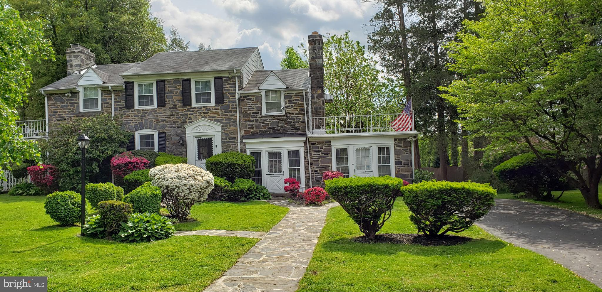 Classic Stone Colonial with multi-generational living potential. Features bright kitchen with  newer refrigerator and garbage disposal (2019), and new flooring 2021.  Large living room with marble fireplace .   First floor bonus:  half bath, 3 walk in storage areas, family room and office with separate outside entrance that can easily be used as an in-law/au-pair/guest suite.   Second floor's 4th bedroom contains the home's 2nd wood burning fireplace,   cedar closet large enough to make into a full bathroom, and a 22' x 14' roof deck.  Finished walkout basement has additional  600 + square  feet with newly installed flooring (2020) in the large multi-purpose and laundry rooms.  Also, has 2 walk-in storage areas and a half bathroom.  Other 2020 improvements include new energy efficient water heater,  rebuilt flagstone porch roof, painted exterior trim and siding, resurfaced driveway and silver coated roof deck .  Yard  has built in stone barbeque pit  and is large enough for a pool.   Home warranty includes all AS IS appliances. This home is a rare find with loads of storage and possibilities waiting for your personal touches.    Located in the award-winning Lower Merion School District.  Minutes from St. Joseph University, transportation,  shopping, restaurants, golf courses.   Current owners have enjoyed this wonderful home and neighborhood for over 20 satisfying years. Owners are licensed real estate agents