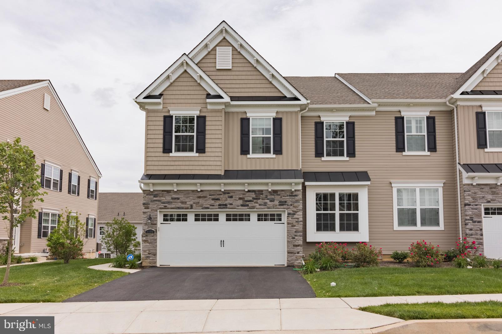 Welcome Home to 1102 Vernon Way, West Chester located in the Reserve at Glen Loch. You can move right in to this meticulously maintained 1-year old end-unit townhome, well-equipped with beautiful finishes,  finished basement and a convenient location that is within a few minutes drive of three commuter train stations. Some key upgrades include: Gourmet Kitchen with quartz countertops and marble subway tile, gas fireplace, upgraded and hardwood flooring that is extended to the 2nd floor, upgraded carpeting and designer paint colors. From the moment you walk through the front door, you'll notice the upgraded cabinetry and hardware in the Kitchen, the French doors on Flex Room, custom lighting and upgraded molding package that enhances the open main floor plan. Upstairs you'll find three spacious bedrooms, two full Bathrooms and the Laundry Room. As if you needed even more space, there is a full finished basement with additional full Bathroom and a nicely finished Garage with painted walls and epoxy coated floor.