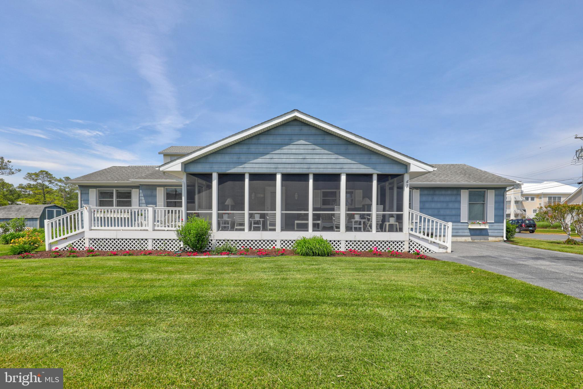 """Situated on 70 x 125 lot and one half parcel, this adorable coastal cottage is in one of the best locations in Bethany Beach, positioned on the """"Loop Canal"""", just a little over one block to the ocean and is in easy walking distance to downtown! The oversized screened porch welcomes you with soaring ceilings and an abundance of natural light to enjoy the breeze on quiet mornings or to nap on a summer afternoon.  The spacious one level floorplan offers an open kitchen/living room area and 4 bedrooms plus an office that could be a small 5th bedroom and 2 full bathrooms.  The outside shower and storage shed make coming and going from the beach a breeze.  Update this meticulously cared for property over time or build your custom dream home with plenty of space for a pool on this oversized parcel -  the possibilities are endless!   Situated just one block to the ocean and only a few streets from the heart of town with its fantastic restaurants and boutique shops, the sale of this property is subject to the sellers maintaining occupancy of the home until September 15, 2021."""