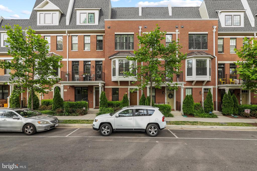 Welcome to 690 Kenneth St NE, a 4-level beautiful townhome on a quiet street, just steps from the hustle and bustle of Brookland. Wonderfully convenient to the metro, restaurants, shops and more! Built in 2016 by Bozzuto homes, no detail was overlooked in this exquisite home with a rooftop terrace overlooking the park. The entrance level includes an inviting space for a den or home office, a half bath, and access to the coveted large garage. An additional parking space outside the garage also conveys.  The main level offers the perfect layout for entertaining, with an open concept kitchen, dining and living room. Prepare your favorite meals in the modern gourmet kitchen, with stainless steel appliances, double ovens and quartz countertops. The third floor includes two bright bedrooms with generous closets and two sleek ensuite baths. A luxurious retreat awaits on the top floor in the primary bedroom suite and private rooftop terrace with panoramic views of the park. A gorgeous home in a prime location, 690 Kenneth ST NE has it all!