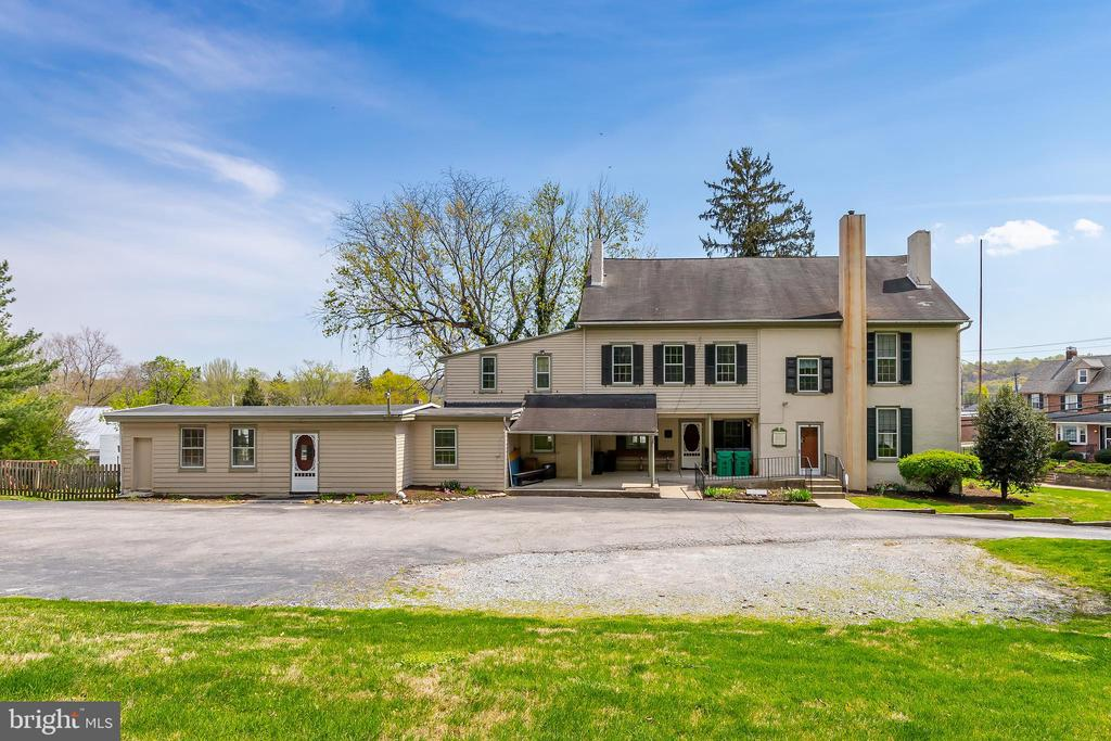 5 – bedrooms  4 – bathrooms  3 – floors  2 – stairs  1 – CIRCA 1790 GEM!  Welcome to 121 Manor Avenue in the heart of Downingtown, situated on 1.4 acres and one of Chester Counties most coveted properties with 8 Fireplaces. This property has stood the test of time in the 231-year history. The 1790 portion is still intact with an impressive number of original attributes including the substantial hearth that is now showcased in todays kitchen and 2nd story which is todays bedroom and bathroom. The cellar is intentionally deep in the original homestead portion and appears to have been utilized as the root/wine/cold storage cellar which is extremely rare in the Delaware Valley. The current owners do know, and the Downingtown Historical Society has confirmed Joseph Downing owned the property from the mid-1800s to the early 1900s however it is not clear who built the original homestead. Sometime in the early 1800s was a substantial addition.  Unique to the Lower Delaware Valley; wooden architecture was instituted while other regions tended to follow brick or stone from their home country. The wooden architecture, random width pine floors, gigantic solid wood doors, oversized windows with 12-inch sills, cabinet work and molding highlight the fine carpentry craftsmanship. In 1922 the Downingtown Womans Club acquired the property for their clubhouse and immediately installed a toilet in the basement for the gentlemen (seriously). It is not clear if the Club made any modifications however, we do know the first meeting at their new clubhouse was in October 1922 and was a thriving organization for many years (fortunately the Downingtown Historical Society houses all the club documents). Fast forward to 1989 when the current owner opened Lori Petrie's Pre-School which has been a landmark for a bit over 30 years. Gentle modifications were completed to transform into the bustling schoolhouse which can be undone to transform it back into an amazing 8,900 sq ft home or Commercial Sp