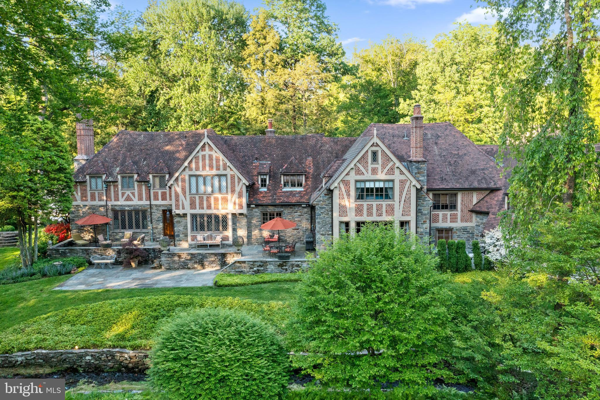 This impeccably renovated and maintained estate home sits on a beautiful, quiet, sought after cul-de-sac street.  This is truly a coveted prime Northside Lower Merion location making this home incomparable in every way.  The original home was built in the Tudor Style circa 1935 by Frank Wilson, a prominent Main Line Builder known for his expertise in structural engineering, truly the glory days of home building.  This home features fine craftsmanship, attention to detail, superior materials, exceptional scale, millwork and stonework very rarely seen in contemporary building trades.  Peter Zimmerman Architects  worked closely with the owners to renovate and substantially expand this home to accommodate a growing family while enhancing the past glory of this beautiful home.  A delightful stream meanders across the front of the property, and the siting of this home allows for truly lovely views of the steam and the expansive grounds from many of the rooms.  A long private drive brings you to an impressive entrance courtyard where you will notice that the addition in this section and courtyard were angled away from the main house to follow the path of the stream and create and expansive approach. The owner worked very closely with the architect to ensure preservation of the original details and integrate award winning details, materials, proportions and layout so finely that only a well-trained architectural historian can tell them apart.  The clay roof tiles were custom made by Ludowici, the same company that manufactured the original tiles, to ensure a perfect match.   The original steel windows were restored, and new ones were reproduced to match, while the extraordinary decorative brickwork and stonework, half timbering, wood and stone details inside and out make it nearly impossible to find the intersection between the original and new construction. The transition on the inside and out is seamless.   Beech Road, Bryn Mawr is a truly coveted location enjoying a very
