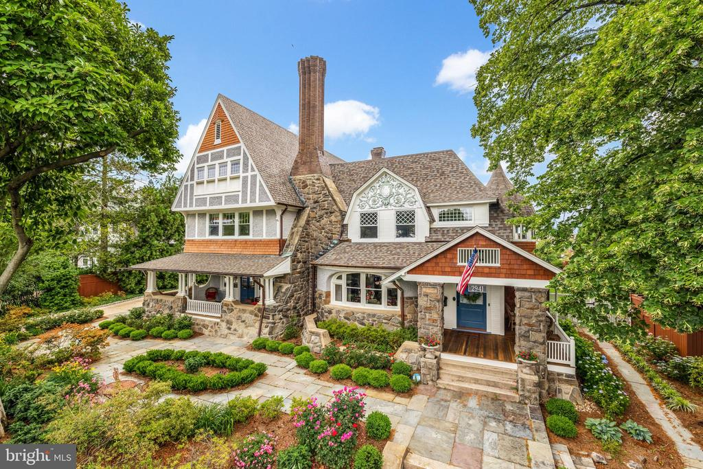 JUST LISTED! NEIGHBORHOOD TREASURE! 1898 grand jewel of historic Cleveland Park in ethereally beautiful setting on tranquil Newark Street with unrivaled privacy and serene city views from multiple large porches and over 1/3 acre of lush surrounding gardens and patios with heated saltwater POOL! Breathtaking turreted Queen Anne facade reveals an expansive, airy interior with 9'+ ceilings and grand-scale, sun-drenched rooms, each with uniquely beautiful artistic windows and millwork - turnkey RENOVATED throughout for today's tastes with countless exquisite periodarchitecturaldetails preserved. Ideal floor plan on main level with NEW open kit/fam room with level walkout to pool patio, breakfast area, and separate mudroom entrance from wide private driveway and garage, large double living room/library, dining room and foyer with grand stairway all walkout to surrounding private outdoor space. Master suite with new bath and dressing room, 2 additional bedrooms with additional full bath and turret room+ laundry on second floor. 2 large bedrooms, 2 full baths on third floor. Spacious, renovated lower level. Plentiful parking and just steps to schools, shops, restaurants, & metro!