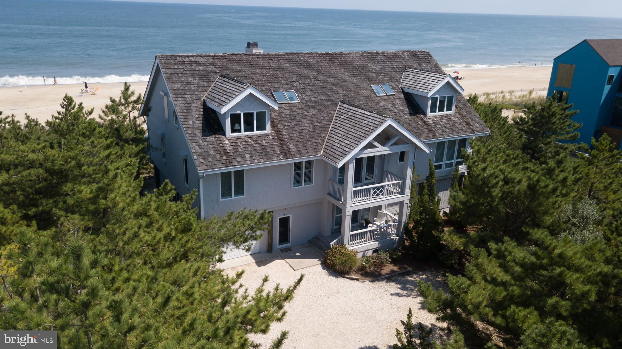 ANY OFFERS MUST BE SUBMITTED BY 4 PM ON SUNDAY, JUNE 12TH TO BE CONSIDERED.    Rare opportunity to purchase an oceanfront home with spectacular views on a double lot in North Bethany!  A 150' by 156' parcel on a private beach is a once in a lifetime possibility.  In addition, the  community  offers both ocean and bay access, tennis courts, and a marina. It is evident to see the care and diligence that has gone into this residence.  The home features timeless architecture, with exposed beams, hardwood floors, soaring ceilings, ample space for family and friends to enjoy all the beach has to offer. The deck off the living room is large enough to accommodate all the furniture and grills to enjoy the panoramic ocean views. There are two master suites, one on the third level and the other on 2nd level. The open floorplan allows for continual  appreciation of the Atlantic Ocean from the living, dining, or kitchen areas, as well as on the  screened porch or  enclosed den off the kitchen.  The lower level offers its own suite , with a separate bathroom, laundry room , access to the  outside showers, and  beach walkway, as well as an entrance to the spacious garage and storage area.  The elevator goes to all floors in the home, including the garage level.