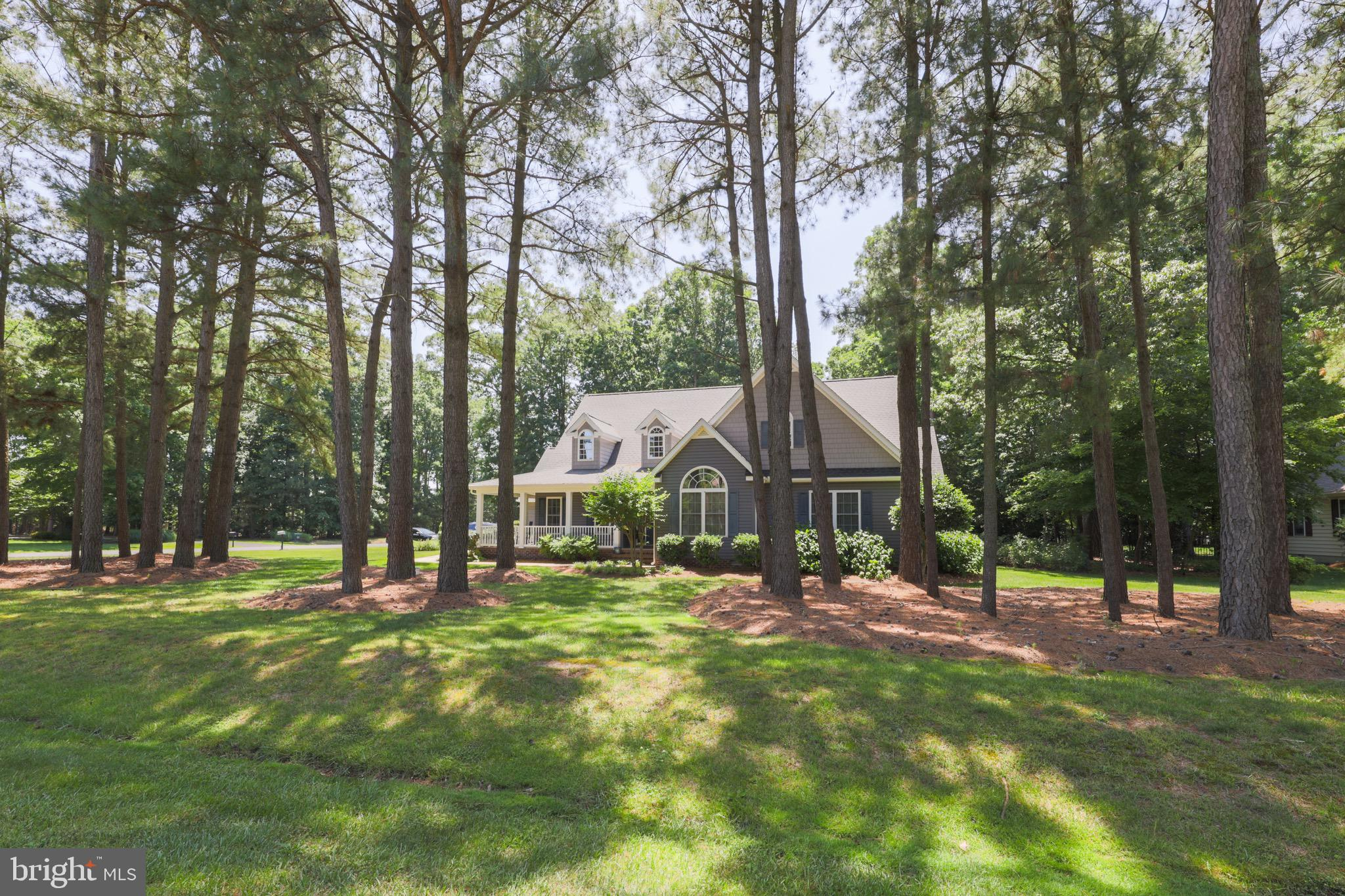 Magnificent home in Milton! This corner lot contemporary 2-story home touts skylights, bay windows, vaulted ceilings, and spectacular open concept floor plan. Striking pigeon gray siding accented with ocean blue shutters 3 BRs/2½ bath over 2,500 sq. ft. home is tucked in community of Red Fox Run, nestled between Rt. 1/Rt. 113. Breathtaking landscaping is statement making! Shrubs and hedges edge brick trimmed wrap-around sprawling covered front porch that looks to mature tree-dotted front lawn. Driveway leads to side-entry, 2-car garage, preserving front-faced home's curb appeal! Step into foyer with soaring ceilings and light-infused space beyond, and clear views through home to back wall. Golden, polished wide-planked hardwood floors are throughout most of main level, while circular layout connects main rooms, offering easy-flow floor plan. Foyer offers side wall, where sofa table/2 chairs fit nicely. 2 grand columns announce entrance into spacious, sun filled LR/FR and set elegant, upscale tone. Vibrantly colored couches, area rugs and pillows adorn huge space, made larger and lighter by vaulted ceiling, cherry ceiling fan and myriad of windows. Bump-out floor-to-ceiling wall is home to gas FP, 2 alcoves on either side of FP offer space for hutch/end tables and mix of windows/glass sliders span back wall. Open to LR/FR is gorgeous gourmet kitchen! Hardwood floors are replaced with beautiful ceramic tile, yet light wood is echoed in maple cabinets. Room above cabinets offer snippets of trailing vines and greenery, brilliantly colored bottles and vases and remembered mementos! Granite countertops are paired with SS appliances. Angled 2-tiered breakfast bar with stools cleverly has dual sink below that looks out to adjoining LR/FR, keeping cook engaged with ongoing conversation. 2-tiered countertop is repeated on opposite side with defined desk area, perfect for catching up on mail and messages. Adjacent to main kitchen is delightful morning room enveloped in 2 walls