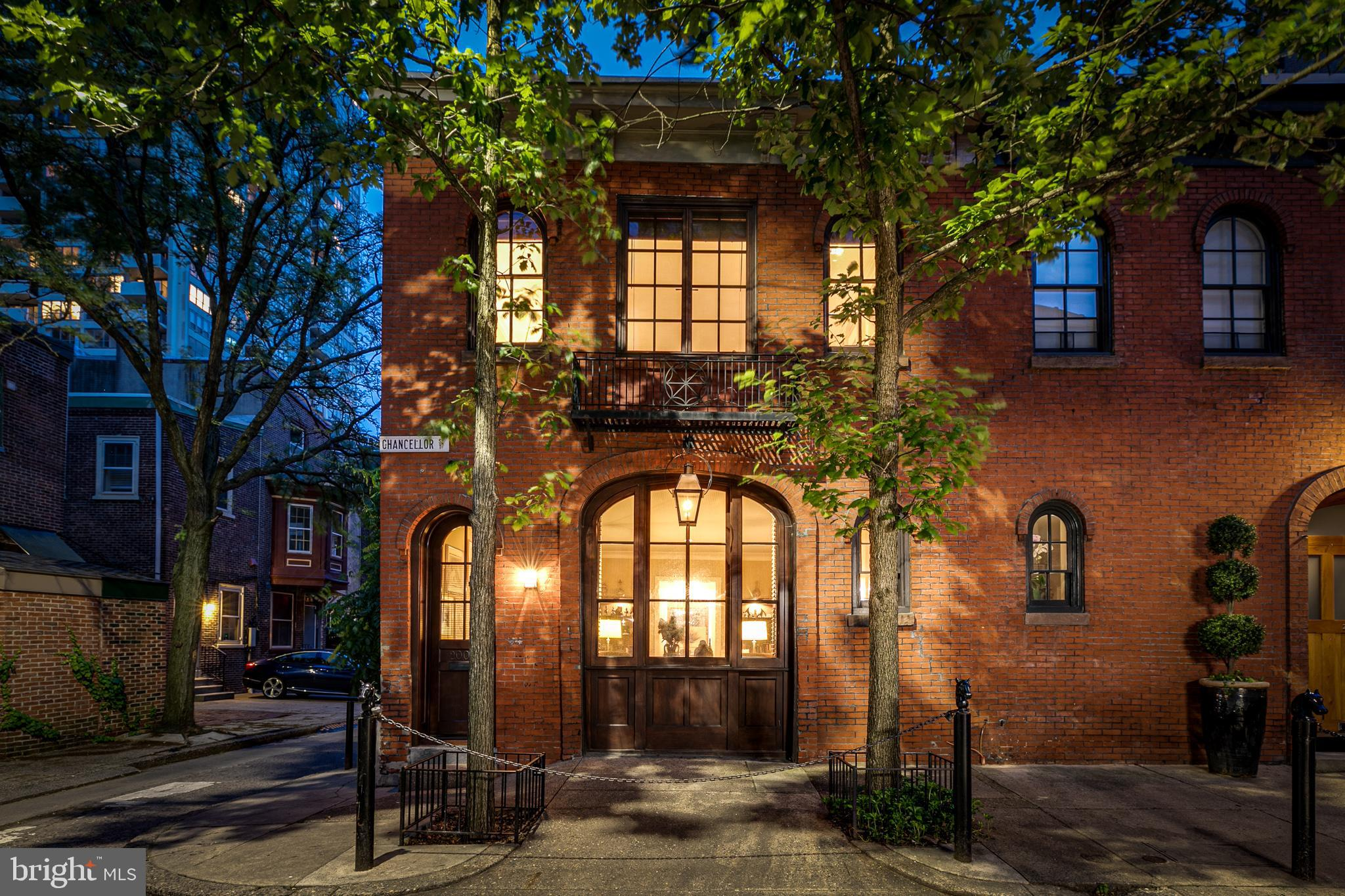 There's something about a carriage house that is particularly fascinating; it might be the arched doorways, brick facades, or the fact that they belong to an entirely different era. This 2400 sq ft corner Carriage House... Uniquely Philadelphia... Contemporary Architectural Design... Open Floor Plan... is a dramatic 2 bedroom plus den home unlike any other. From the striking landmarked mahogany multi-windowed façade of dark wood and old brick to the light-filled differently defined levels for living, this carriage house will excite just crossing the threshold.  On the entry-level is an open living and dining with fantastic handmade moldings and a fireplace. The center hall features wood floors from Bologna with a sleek steel and wood staircase. Adjacent there is a full laundry room and powder room. Walk into the windowed cook's kitchen with amazing storage and eat-in dining. The beamed ceiling is original to the carriage house and there are double mahogany doors that lead to the rear of the property. Up one flight to the den/library sit and relax with your favorite book and a cafe. This level features the primary suite with walled bookcases, walk-in closet and en-suite bath with water closet. There is a 2nd bedroom also with an en-suite bath and a walk-in closet. Then it is up to the beautifully decked and planted roof garden. Traversing the center of the carriage house is a skylight that brings in magical light day and night. Located on the most desired Chancellor Street in the heart of Rittenhouse Square, one of the most sought after  Rittenhouse brownstone neighborhoods, you are near shopping and world-famous museums plus fine food purveyors, and an electrifying array of restaurants and bars. Words do not capture this unique and dramatic home so to really appreciate it you must see it yourself!