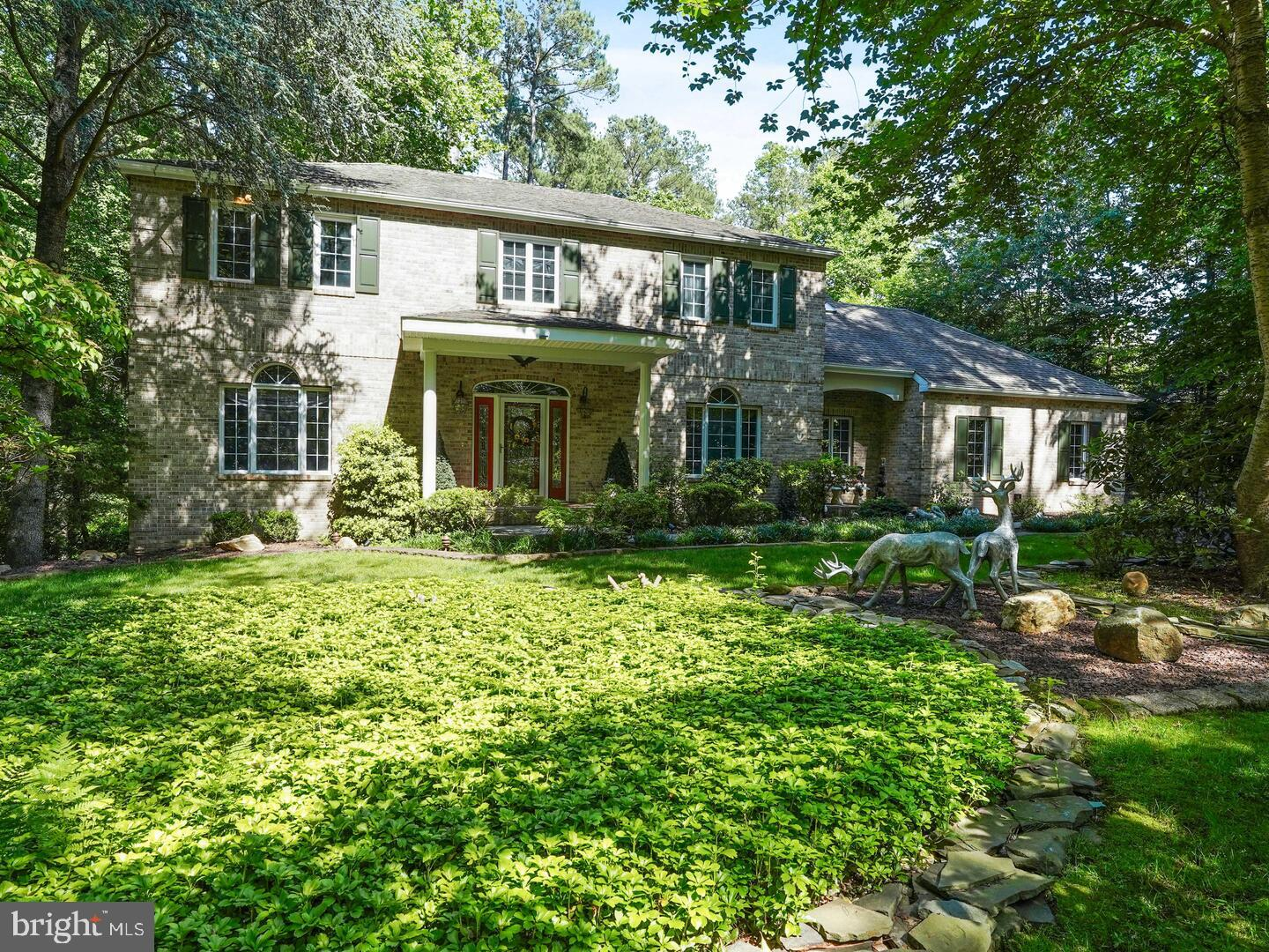 """A Rare opportunity to find a  1.6+ Acre Home site that backs to a Stream and Protected Woodlands,  in a small enclave of 21 Custom Homes, just off Route # 896 and North West of the U of D.  This Custom built home features 5 Bedrooms, 3.1 Baths with  over 5000 Sq. Ft. of Living space on three levels of living.  The Original Owner has lovingly maintained and upgraded this Home, with an endless list of  Custom features that are apparent as you pull into this  lovely mini-Estate. As you enter the home you will immediately be impressed with the Level of Care and Custom features that you are treated to, as you walk through the Home, The entry Foyer is highlighted  with a marble tile floor,  Chair and Crown molding and is flanked by the Formal areas of the home. The Foyer, Living & Dining areas room immediately set the tone for this Lovely Home with  Custom Lighting  upgrades, extensive Millwork,  gorgeous Tile and Hardwood floors, that lead you into the more casual areas such as the Grand Family room that features a floor to ceiling Brick fireplace with Granite Hearth, two eyeball  and three recessed  lights also a vaulted ceiling with two skylights, and an oversized slider that leads to a 30' x 13' Glass enclosed Four Season Room, with cathedral ceiling and two skylights. The Kitchen features 42""""  Raised Panel all wood Cabinets, w/ Crown molding, loads of base cabinet drawers, Wine & Cubby storage, Corian  Counter top, Tile backsplash and an 11'  Center Island w/ a Breakfast Bar & Granite counter top, double door Pantry, 8 recessed lights, all Upgraded appliances are included, plus there is a 19' x 10' Breakfast room  with a Desk and Bar area, highlighted with a Vaulted ceiling and another set of sliders to the Florida Room. The first floor does feature a Guest bedroom, plus a step saving Tile floor Laundry with a Sink, Storage cabinets, Service door(Washer & Dryer included) The Upper floor hallway features Wainscoting & Hardwood floors that lead to the Primary Suite, wi"""