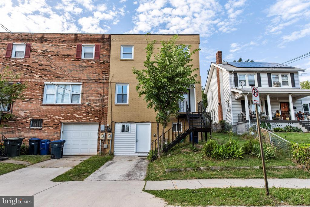 Updated 5 bedrooms 4 baths semi-detached townhouse in DC's Brookland/Woodbridge area! Rent out the private basement with its own entrance, full kitchen, full bath, and two bedrooms. The main kitchen has been renovated with granite counters and is complete with stainless appliances and tile floors throughout. Large open living space connects to the dining area and into the kitchen. Find the deck off the kitchen area that looks into a nice fenced-in backyard. Hardwood floors throughout the main area of the home and upon the second level where you will find 3 large bedrooms and 2 full baths. Come by and check out this beautiful home with options to bring in additional income from the basement living space.