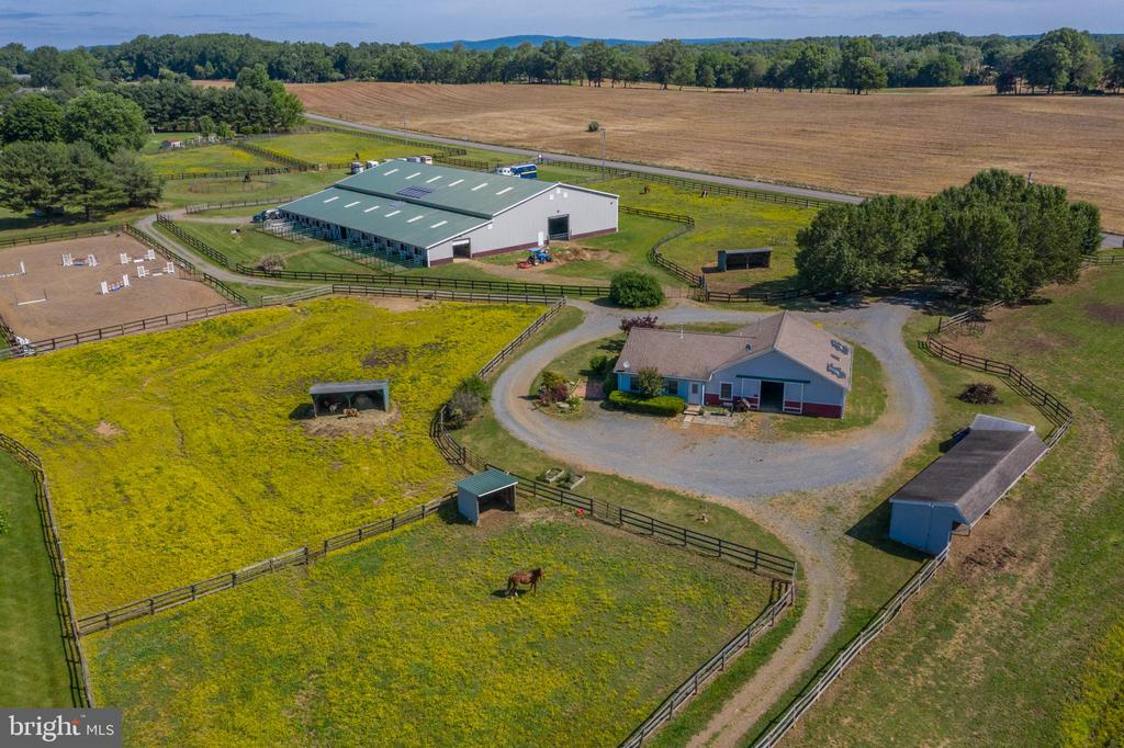 Welcome to the dream equestrian estate.  This property has everything the serious amateur, professional, or investor is looking for.  Located in Warrenton Virginia in the heart of horse country, with access to D.C.  This property boasts a custom built 4 bedroom main house, with attached 3 car garage, 15 stall center aisle barn, attached to indoor arena, viewing room, hay storage, shavings storage, jump storage, 2 wash stalls, 3 tack up areas, feed room, tack room, bathroom/laundry room.  The main barn is solar powered so no electrical bills!  The guest house is a gorgeous single level ranch home with 3 bedrooms, 1 bathroom, lilly pond, and 3 stall barn.  Each home has it's own septic/well/generator.  The guest house and barn have a private driveway, the Indoor and main barn have a driveway with a parking lot for horse trailers, and the main house has a paved driveway with a 3 car garage.  This property is currently income producing with two tenants.  However their lease can be terminated with 60 days notice.