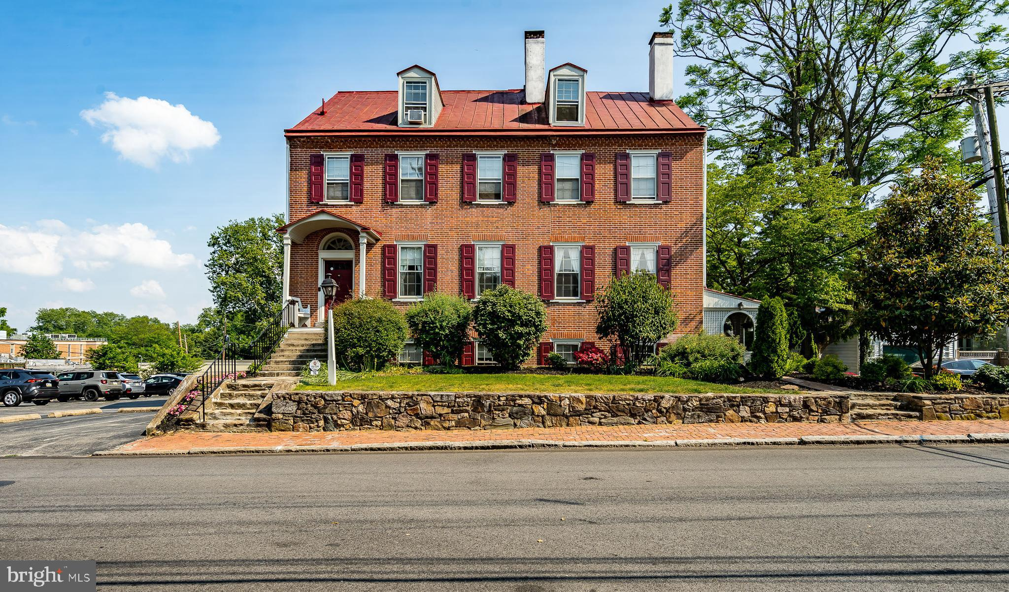 This exceptional residence dates back to 1830. A one of  kind single family residence occupied on the main level by Sellers. Spectacular and high end improvements are enjoyed by the owners with the luxury of collecting addition rent from 2- 3 bedroom 1- 2 bedroom apartments. Also with a private entrance is a one bedroom in-law suite. The original charm is both inside and outside. The rear yard is spacious and includes lush landscaping. Rarely found in the middle of the Borough. A unique 2 car detached garage is included of a dismantled barn. It is prime location walking distance to all Borough amenities.