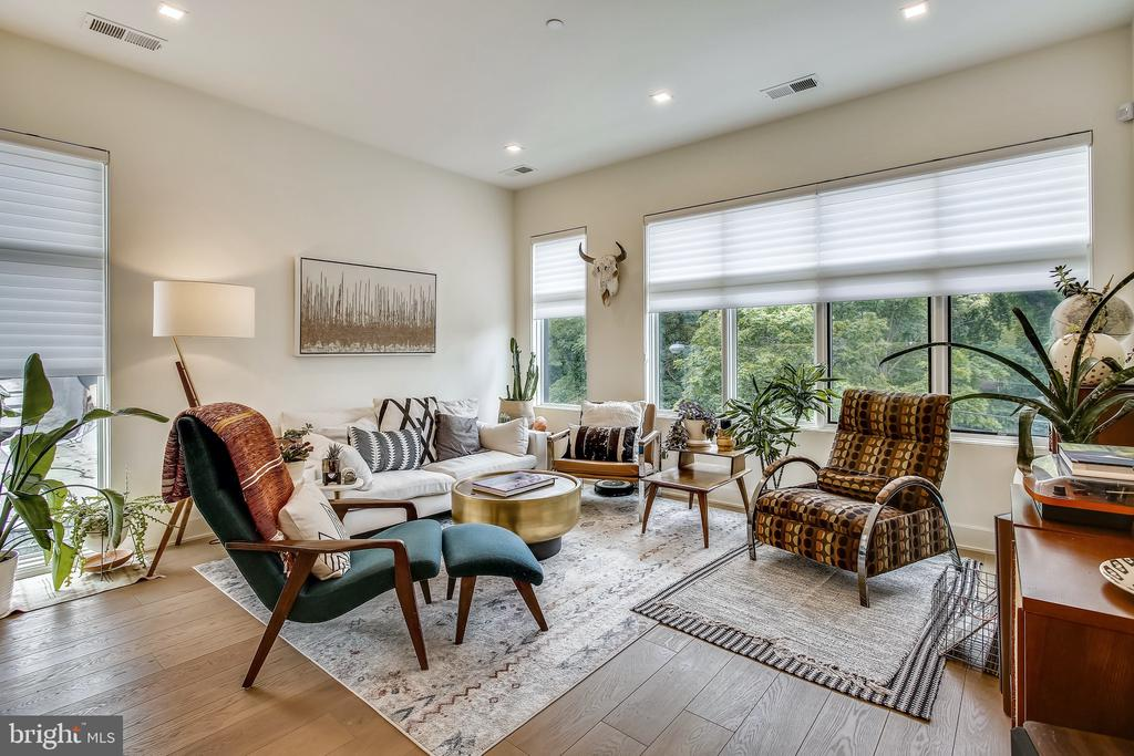 MOTIVATED SELLER- PRICE UPDATE!!    Built in 2019 (soon thereafter vacated and is delivered to you practically new!) this comfortable, friendly boutique condo building is sure to please.  Unit 6 is a BIG BRIGHT TOP FLOOR 2 Bed 2 Bath unit featuring 2 PARKING spaces and OUTDOOR SPACE GALORE with 2 balconies off the bedrooms in addition to a HUGE (+/- 225sf) PRIVATE ROOF DECK with Monumental Views of Downtown Washington, DC.    Additional features include nearly OVERWHELMING CLOSET STORAGE, 11' CEILINGS, wide plank hardwood floors, LIKE NEW KITCHEN appliances & bathroom fixtures and video entry system.    The owner upgraded the unit with Lutron - LED smart lights/dimmers (can be controlled by smart device), Hunter Douglas Silhouette window treatments throughout with HD black out shades in the primary bedroom; an exterior ring security system on the back door and roof deck and is wired with upgraded high speed Verizon internet.    The kitchen features quartz counters with waterfall, a stainless steel Kitchen Aid appliance suite, brushed nickel fixtures, under cabinet lighting and plenty of cabinet storage.    Both bedrooms are SPACIOUS, BRIGHT, offer an amazing amount of closet space and outdoor balcony access.  The unit is walking distance to the Rhode Island Metro for an easy commute. Close to all of the shops and dining that Brookland has to offer including Menomale, Primrose, Brookland's Finest, Right Proper Brewery, and Tastemakers to name a few.