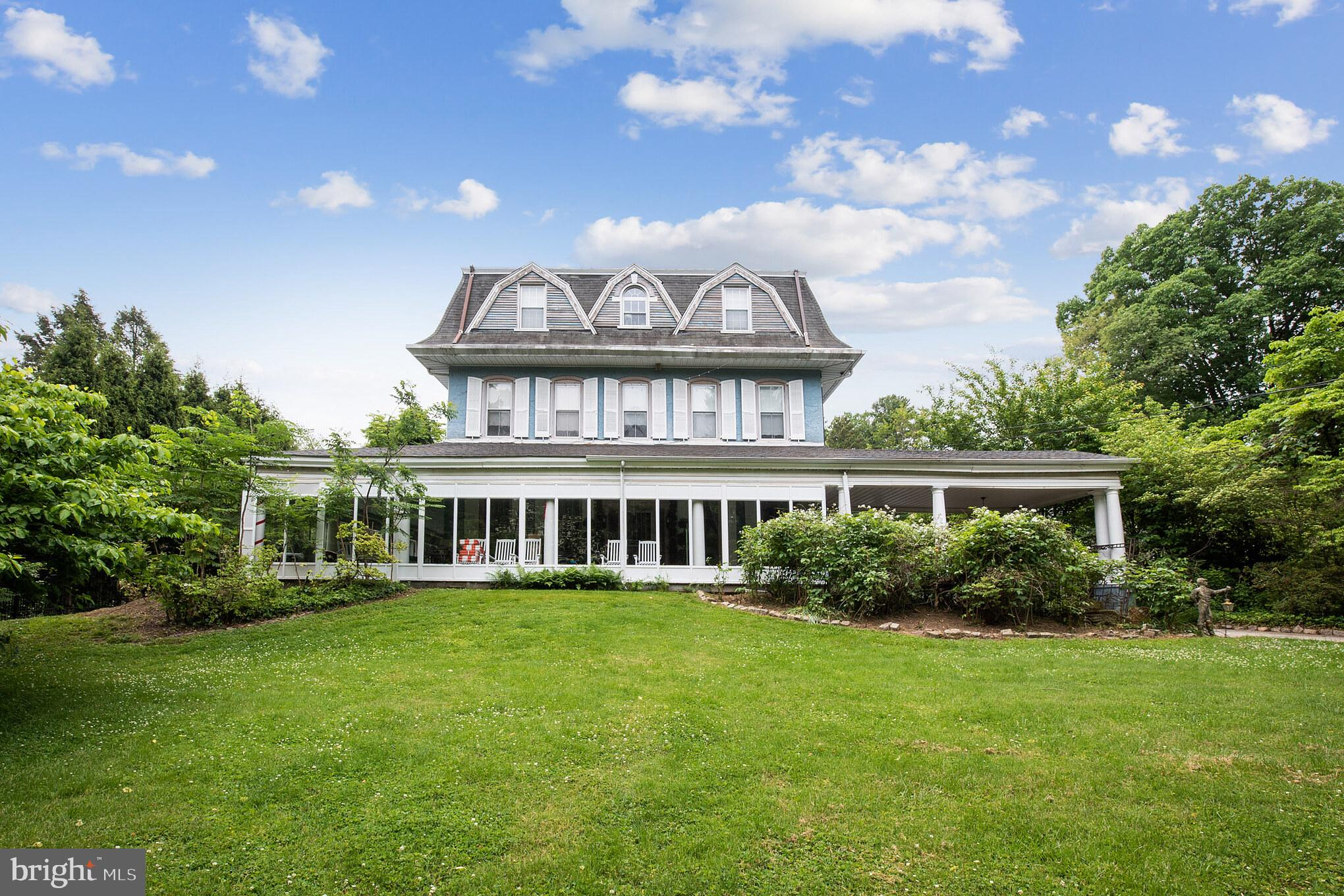 Incredible opportunity to purchase a piece of Main Line History! Offered for the first time in over 60 years, this stunning estate was built in approx. 1878 for Silas Jones, who resided on the original 90 acre parcel owned by his grandfather Jonathan Jones, who was granted the land from William Penn. The house, constructed of stone, is of Victorian style, with typical architectural elements such as a Mansard roof with dormers, a large wrap around porch and projecting bay windows. A gabled porte cochere welcomed horse drawn carriages when built, and now serves as a circular driveway for modern use. Exquisite features include 10 ft ceilings on the main and second levels, original leaded glass details on some windows, grand entertaining spaces and a dramatic wrap-around front porch overlooking the private grounds. This five bedroom, four full and two half bath home has been meticulously maintained and expanded through the years for modern living. This property is registered as a Class II Historic property with Lower Merion Township. Beautiful original chestnut wide plank floors greet you in the center hall foyer and run throughout most of the main level. To your right sits the study complete with floor to ceiling windows, custom-built mahogany shelving and matching crown and baseboard moldings. The formal dining room sits opposite the study with white painted moldings, floor to ceiling windows with built-in benches, and a cozy wood-burning fireplace at the center. A butler's pantry connects the dining room to the living room, providing an extra serving area for entertaining. The spacious living room features beautiful leaded glass paneled windows, built-in window seating and a wood-burning fireplace tucked away under a graceful archway in the center of the room. The gourmet kitchen was renovated and expanded in approx. 2003 and is the showpiece of the home. A nineteen foot long island runs the length of the kitchen and provides an abundance of storage along with hostin
