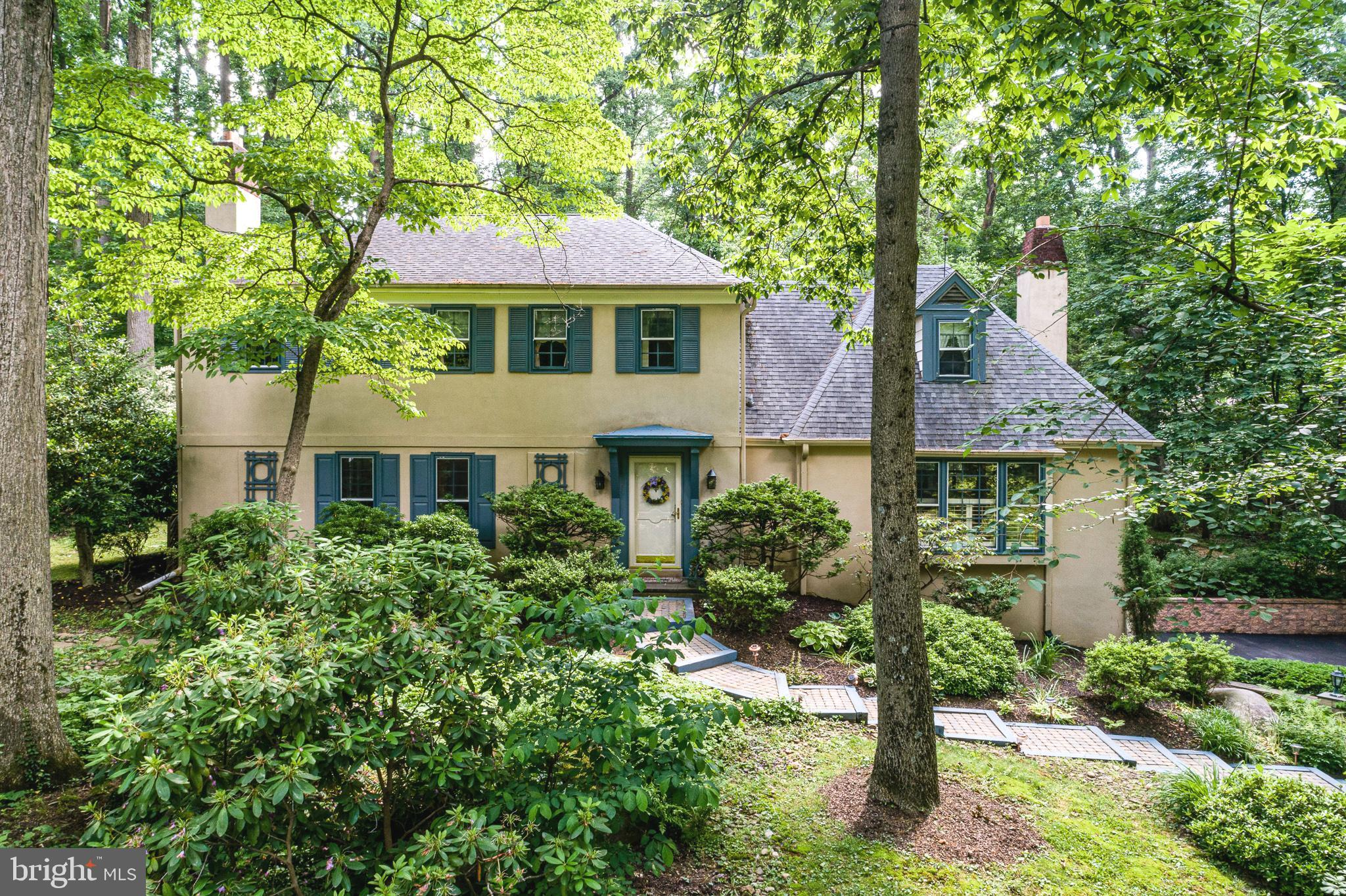Are you looking for an Oasis,  a place to enjoy nature but still be within minutes of all Newtown Square has to Offer?  Set on a quiet cul-de-sac in the sought-after Green Countrie neighborhood this home has it all!  Step into the backyard and you are surrounded by the beautiful plantings and award-winning water gardens, with extensive hardscaping, a charming Gazebo tea house and mature Landscaping for privacy, you won't believe you are in the heart of Newtown Square!  Entering this picturesque French Colonial you are greeted by the generous entry foyer and drawn in by the beautiful hardwood floors, sunlit spaces, and an open flowing floor plan perfect for entertaining.  The Gourmet eat-in kitchen features a granite-topped island with prep sink, designer backsplash, custom cabinetry, under cabinet lighting, sub zero refrigerator & high end stainless steel appliances. The kitchen is open to the breakfast room with bay window allowing for sunshine to stream in and beautiful views of the back gardens. The kitchen opens to the dining room which has French Doors that open onto the patio, perfect for indoor/outdoor entertaining.  The dining room is open to the oversized living room, which has room for multiple seating areas and features a wood burning fireplace with marble surround. A large Family room also with a fireplace has a built in bar and is a wonderful spot to entertain.  A mud room, laundry room and updated powder room complete this level.  Upstairs there are 4 Bedrooms and 3 full baths.  The expansive Primary Bedroom Suite is impressive with double closets, dressing area and a full bathroom.  At the end of the hall is an en suite bedroom with neutral bath. Bedrooms 3 & 4 share the renovated hall bath with double vanity and soaking tub/shower combo.  The lower level has a rec room area, a powder room, a work shop and a private den/office.  This leads to the two car garage also with ample storage space.  Outside is a stunning oasis with beautiful gardens that blo