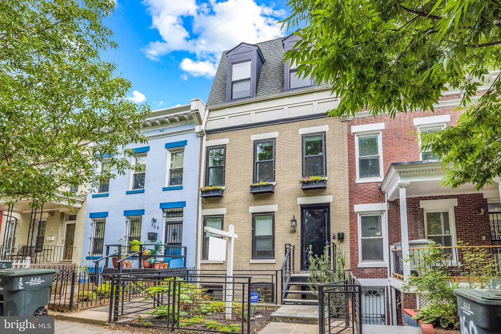 This extremely well proportioned two-level penthouse with ROOF DECK is an unsuspecting gem in Bloomingdale. Stunning city vistas from the roof deck - enjoy dramatic monument, capitol, and city skyline views. First open this Sunday 6/13 from 1-4 PM! Tranquil 2 BR 2.5 BA lives like a sanctuary on a hill - along with the sweeping city views in the back and on the roof, there is no shortage of greenery: beautifully landscaped neighboring yards are a nice match to the manicured green hills across the street. In front, there are no residential properties for the entire block on the opposite side of Bryant Street. The unit has lovely natural sunlight throughout the day. High ceilings add to the grandiose feeling in every room as well as tremendous amount of space to all closets this increasing possibilities for convenient storage.  A kitchen with a gas range, marble slab countertops, and plenty of room for a large dining table for entertaining and gathering. Beautiful, modern and well-designed bathrooms, spacious bedrooms, ample storage, exposed brick, and lovely hardwood floors. Bloomingdale is a flourishing neighborhood rich with history, adjacent to LeDroit Park. You can walk to Crispus Attucks or LeDroit Park, and just about everything you could need along the 1st Street NW and Rhode Island Ave NW intersections. The Farmer's Market is perfection, located next door to the dreamy Big Bear Cafe with tons of outdoor seating, or enjoy one of DC's top restaurants, The Red Hen.  Walk to Shaw metro, easy access to bus lines and bike share, a great place to live and commute.