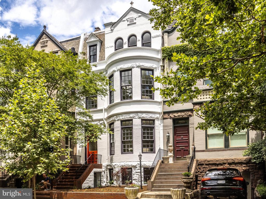 """This Grand Victorian is perfectly located in Kalorama, just steps to Georgetown, Westend, and Dupont Circle.  Original details from the heart of pine wood flooring, to the bold crown moldings, and 6  fireplaces combined with a  modern Chef's Kitchen, 3 skylights, and french doors leading to a beautiful landscaped rear patio are just some of the features you will find in this remarkable home.   This home is south facing and light filled with 11' ceilings on main level, 10' on 2nd level and 8'9"""" on both the 3rd and lower levels.  2nd and 3rd floors offer 2/3 bedrooms and full bath with laundry on the 3rd level.   The lower level is a perfect in-law suite or potential rental income with one large bedroom, tons, of closets, kitchen, and full bath with laundry.  Open Sat 6/12 and Sun 6/13, 1-4pm.  Rental parking at neighbors detached garage is paid through September, space can be leased indefinitely."""