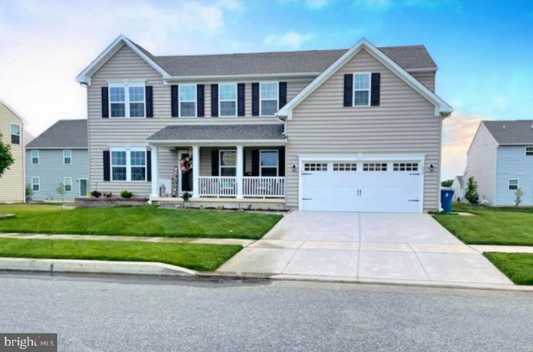 """Don't miss out on this rare opportunity to own a home in High Hook Farms located minutes from Route 1 and I-95 in northern Middletown and in the Appoquinimink School District. This VERONA model is the largest in the neighborhood and has it all. Featuring 5 Bedrooms all on upper level, 3.5 Bathrooms, Study on Main Level, Laundry Room on the upper level, Finished Basement, Front Porch & Much More!  .  As you enter this traditional center hall colonial, flanking the Foyer is a formal Living Room and Dining Room.  As you continue your way to the rear of the home you will notice the extensive Great Room with a fireplace which opens to the upgraded Kitchen with 42"""" Maple Expresso Cabinets, granite countertops, stainless steel appliances, enlarged, double sized kitchen island, walk in pantry and upgraded hardwood flooring.  The mud room was removed to make the Kitchen even larger. Complete with  a  study/office and half bath on the main level.  Upstairs are five spacious bedrooms, 2 full baths and an airy 2nd Floor Laundry.  The bonus room over the garage was converted into the 5th bedroom and is more than generously sized.  The Owner's Suite has a large walk-in closet and private bathroom featuring a separate soaking tub and walk-in-shower.  The lower level features a finished basement with a full bathroom and an egress window.  Outside is a lucious green lawn with sprinkler system.  This community has a """"Family Complex"""" complete with soccer fields, a playground, gazebo and dog bark park.  Make your appointment today!  Hurry, this one won't last long!"""