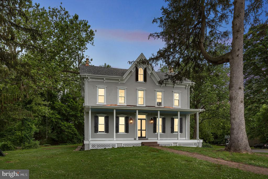 This beautifully restored Victorian Farmhouse with extensive updates and luxurious features is a must-see! Built in the 1880s, the impressive three-story home was the original land owner's home for the surrounding 500 acres of Barton Meadows and offers 6 bedrooms and 2.5 baths and 3,560 finished sq ft,  Extensive upgrades of the home include newly renovated bedrooms with new wall-to-wall carpeting, updated bathrooms, new double-pane windows, new 5 zone heating system with a 96% efficient digital furnace, updated plumbing and electric, new 80-gallon hot water heater, an entirely new roof system with brand new decking, shingles, fascia, soffit, all new gutters and copper work (including on each of the three porches), and so much more! Upon entering the main floor, you will be greeted by original locally milled hardwood floors. Throughout the home, you'll find new chandeliers and lighting, and large window boxes (which provide stunning views including a 28 acre preserved farmland right across the street). From the foyer, there is an elegant living room to the left, with newly installed crown molding and a gorgeous mantel fireplace, and a bright formal dining room (currently used as a craft room/office) to the right. Proceed to the updated kitchen featuring butcher block countertops with ample counter space, cabinetry for storage, a two-tiered island, corner workstation, tile flooring, and dining area with a fire-burning stove. Finishing off the main floor is a butler's pantry and a convenient half bath. Upstairs, the primary suite is delightful, with tons of natural light and a huge bathroom (featuring a walk-in shower and ample closet space). The two other bedrooms on this level are equally spacious with ample closet space and big windows. Down the hallway is an open study with great natural light and exposed hardwood built-in shelves. A laundry room and a full bath complete the second level. Continuing upstairs to the top level of the home are the three remaining bed