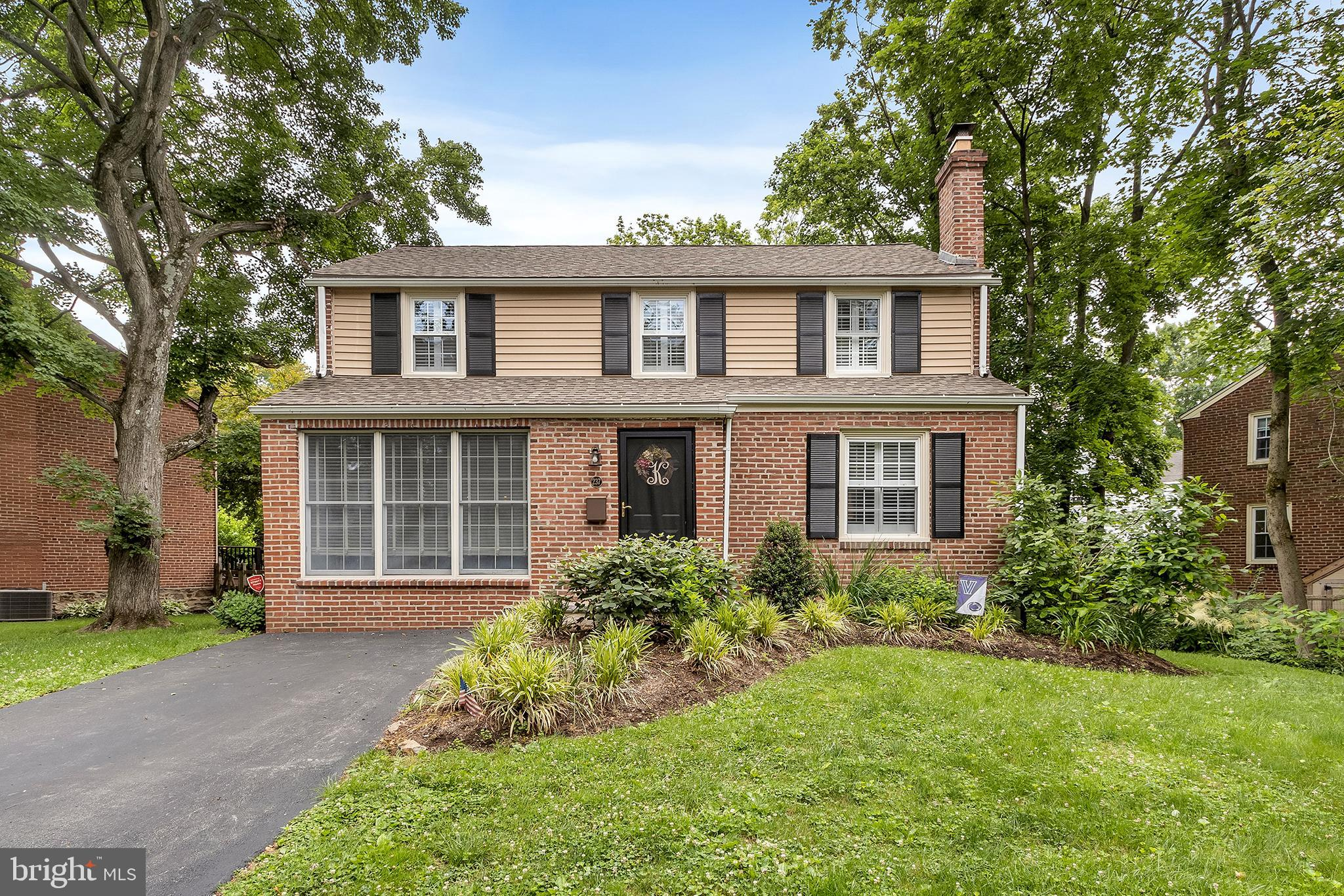 **Over 2,184 square feet of finished living space.  Check Floor Plans Available Online**This charming, updated brick-front colonial home perched on a quiet, leafy circle in sought-after Radnor Township features all the amenities and thoughtful touches today's buyers desire, including a larger floor plan with an easy, family-friendly flow. The functional, open-concept first level boasts wide-plank, hand-scraped hardwood floors throughout, along with neutral paint, plantation shutters, oversize windows, high-end light fixtures and custom moldings. The gracious living room—which includes a wood-burning fireplace and built-in bookshelves—connects to a spacious, light-filled dining room that's perfect for entertaining. The updated kitchen spans the entire width of the home and features a farmhouse sink, new stainless steel appliances, granite countertops, a butler's pantry with wine fridge and convenient sliding door access to the lush backyard. A lovely family room with floor-to-ceiling windows completes this well-designed first floor. On the fully carpeted lower level, you'll find a cozy family room and half bath, plus an oversize laundry room with space for storage and a second refrigerator. The upper level includes three well-sized bedrooms, including a primary suite with full bath and secondary bedroom with custom closet organization system. Buyers will also appreciate the aged oak floors, plantation shutters and neutral paint throughout this floor, plus a recently updated full hallway bath. The backyard offers an ideal (and low-maintenance!) escape with its composite deck and railing, ample greenspace and storage shed. Located in a friendly, sidewalk-lined neighborhood within walking distance to Clem Macrone Park, the Rosemont Train Station and Villanova University, and Radnor School District —just named the top school district in Pennsylvania! Schedule your appointment today!  Please Note that Delaware County is conducting a real estate tax assessment, effective J