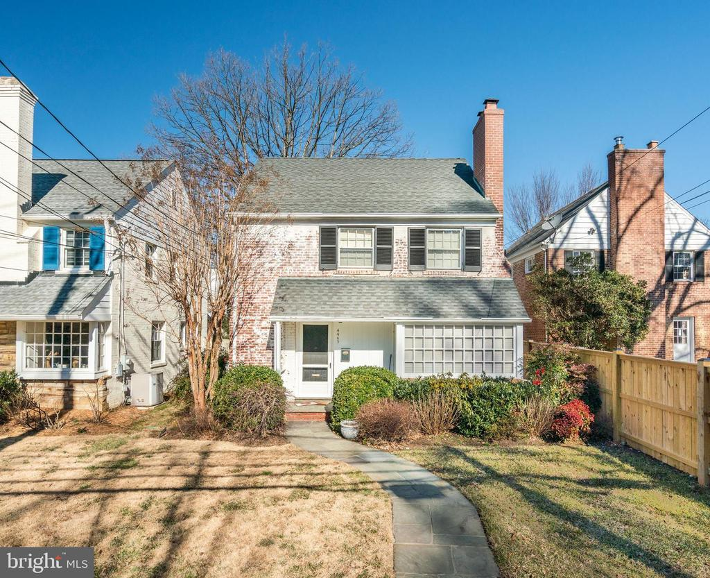Absolutely charming updated brick colonial on quiet street in Foxhall.   Gleaming hardwood floors, sunny and bright throughout this cozy home.  Light soaring through the oversize bay window greets you as you walk into the home.  Living room is centered around the hearth of the wood burning fireplace and is open to the spacious dining room with French doors to the splendid patio and backyard. Updated kitchen with marble countertops, stainless steel appliances and white cabinetry. Upper level boasts three bedrooms and two full baths.  Marble tiled and recently renovated, enjoy the soaking tub in the hall bath.  Lower level with full bath, laundry and large recreation room or fourth bedroom.  Backyard with slate patio, manicured plantings and mature trees.  One car garage with storage.  Make this one your own.