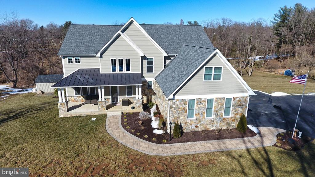 Stunning 5 Bedroom 5 1/2 Bath Custom designed Colonial resting on 1.66 acres.  Boasting 5100+ Sq Ft of living space on 3 finished levels, the multitude of features include a 2 story entryway,  hardwood flooring on the main level, crown mouldings and custom trim, Formal Dining Room, Private Home office, Mudroom area, and  Gourmet Kitchen with stainless appliances, upgraded counter tops, island, Breakfast bar, double wall oven, and amazing Butler area with prep area and an oversized pantry! Upper level houses 4 Bedrooms including the Primary Owner's Suite complete with sitting room, luxury bath, and a walk-in closet that must be seen! Each additional Junior Bedroom comes with their own private attached baths. Lower level features an in-law suite perfect for guests including a  Great Room, Game area, Kitchenette, Bedroom, and Full Bath. Walk outside to the patio area leading to the in-ground pool and hot tub, or relax on the trex deck with covered pergola area.2 storage building, as well as a 3 car side load over-sized garage and driveway with turn around and space for plenty of parking!! This home has everything one would need!