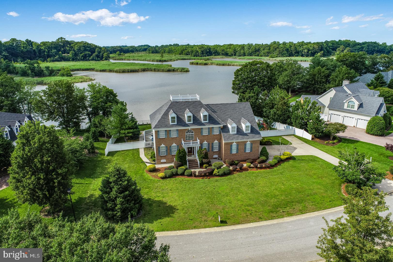 EXTREMELY RARE opportunity to own one of the most panoramic and private waterfront views of Issac Branch segment of the St. Jones River, in the esteemed neighborhood of Windswept.  This move-in-ready home offers over 3400 square feet of ideal living space. Enter the welcoming foyer and enjoy warm hardwood floors throughout both levels. The expansive renovated gourmet kitchen features an abundance of custom cabinetry, generous granite countertop space, stainless steel appliances, and an eat-in-space wrapped in windows. Bask in the serenity and tranquility created by the open floor plan, copious natural light,and recessed lighting. Other features of the main level include a formal dining room with chair rail molding detail and an office with pond views at the front of the home. The family room features a gas fireplace and a sliding door leading to the multi level deck. The upper level of the home boasts chair rail molding in the wide hall, a very spacious master suite with a sliding door leading to a private balcony to enjoy the incredible views while you sip your morning coffee. Four other generously sized bedrooms share two renovated bathrooms, including one bedroom with en suite bath.  Tap into the potential - the full unfinished basement offers ample storage and/or the opportunity to create additional entertaining space. The basement has been fully waterproofed including installation of 2 sump pumps with backup battery, vapor barrier, and floor drainage system throughout.  This home boasts numerous additional upgrades throughout including a gated in-ground pool with new liner and new motor, brand new roof installed in May 2021,  new bulkhead, two zone HVAC systems both recently replaced, tankless continuous hot water heater, irrigation system, aluminum and vinyl fences installed, new carpet in bedrooms upstairs, whole house paint,  incredible landscape, all situated on a generously sized lot in a highly coveted neighborhood. Wake up to the amazing views that a wat