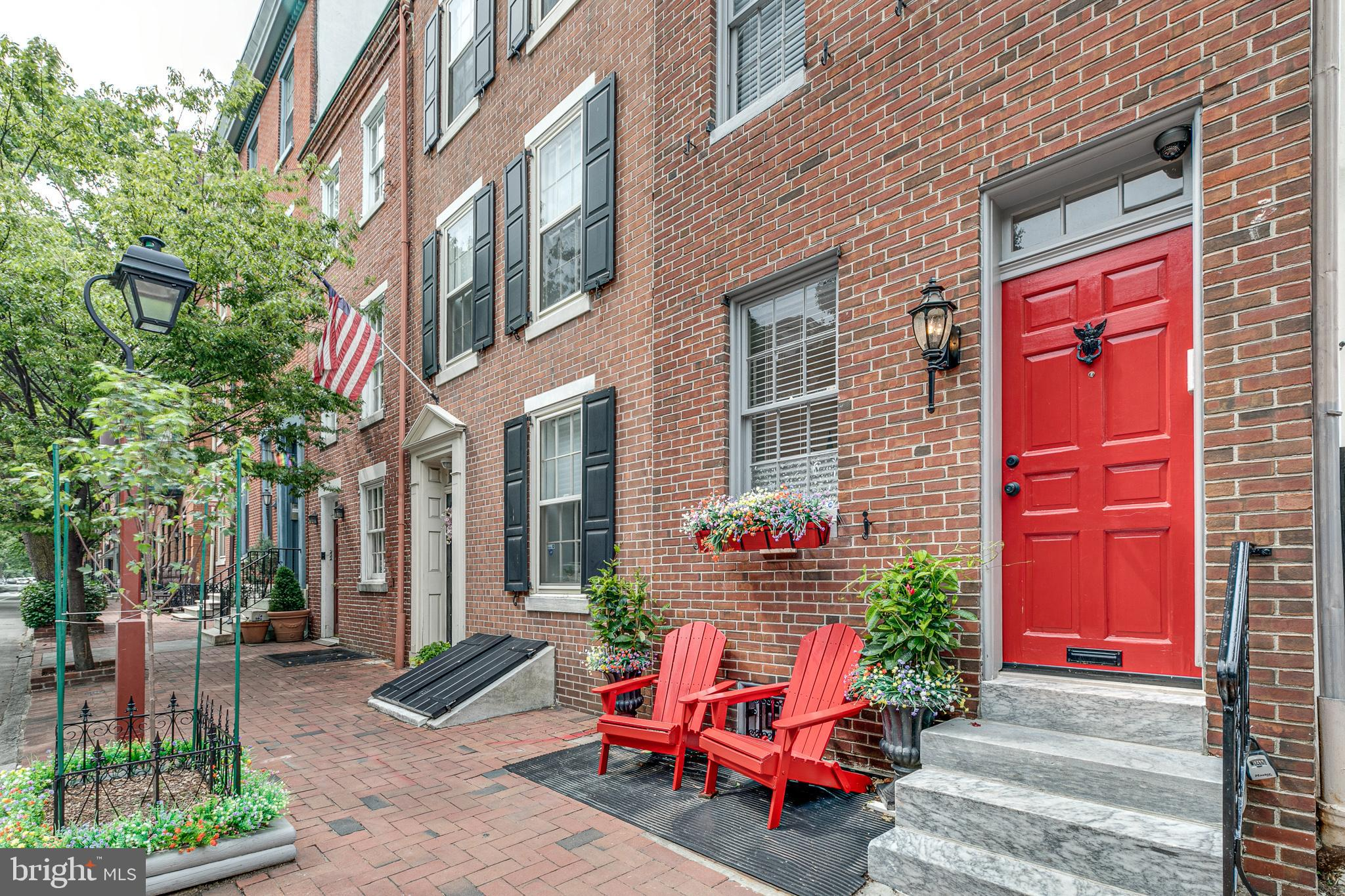 """Welcome to 221 Pine Street!   A unique one-of-a-kind """"Suburb-City Lifestyle"""", historic home that is unmatched in Society Hill. There is not a better location in Center City Philadelphia to own and enjoy a 5 Bedroom - 5 Bathroom Luxury Townhome.  221 Pine has privacy that is a rare find at any prime location in the city today. The home boasts multiple decks & outdoor spaces, a spacious yard with a vegetable garden & patio to barbeque, separate guest quarters and kitchen, luxury finishes throughout, and so much more! This property is located directly adjacent to Head House Square so it's directly next to great restaurants and amenities plus the neighborhood perks include everything from easy access to beautiful park spaces and even easier parking with a garage just a block away. This luxury home is within walking distance to some of the city's best attractions including Old City, Penn's Landing, South Street, and more!   You just have to look over your right shoulder to see Head House Square as you enter into the home from Pine Street. The first floor is being affectionately called the """"guest quarters"""" you open the door on the left side of the hall and go in to view the living room to the left and a well-appointed kitchen with granite countertops to the right. Continue down the hall to the large marble bathroom and bedroom. The first floor boasts ample space to entertain friends both indoors or outside in your full-length yard and patio space. There is easy access from the side and rear of the home to the exterior amenities. You decide to step out back to view the private patio and then stroll through the yard noticing the beautiful trees, rose bushes, and vegetable garden. You enter back into the house up the side stairs and through the side door. Before leaving the """"guest quarters"""", we head down to the recently finished basement and 5th bedroom with its marble bathroom and separated maintenance room with all new services.  On the 2nd floor, visit the living room (Br"""