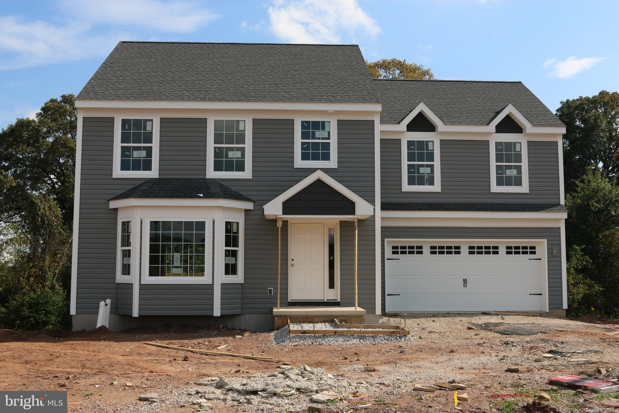 4 BR, 2.5 BA Ellington Model home, featuring stainless appliances, crown molding on kitchen cabinets, built-in bench in primary bedroom, 2nd floor laundry