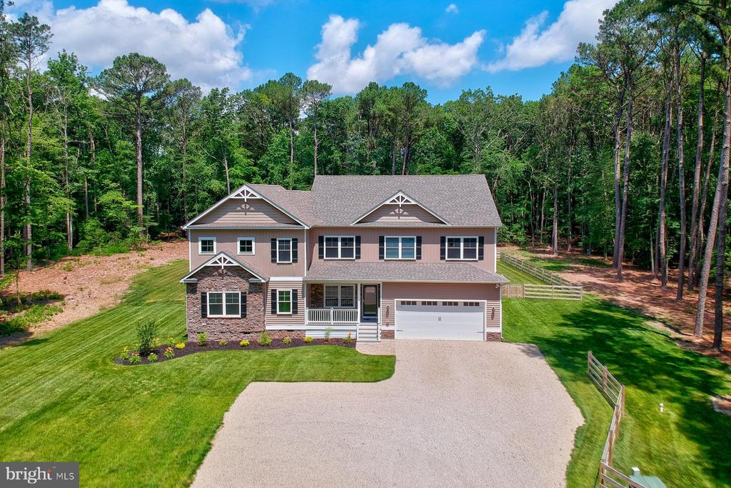 Sellers unexpectedly relocating, no need to wait or spend extra costs to build a new home. This one-of-a-kind custom-built new home boasts numerous upgrades and high-end finishing. Built in 2019 by Piney Island Builders, almost 4,500 square feet, move in ready with 5 spacious bedrooms, 4 full and 1 half bathrooms. Welcome friends and family into the large open living space with combined living /dining area which provides plenty of room to entertain. Gourmet kitchen features energy-efficient stainless-steel appliances and a stylish backsplash. Relax in the oversized 2nd floor family room with built-ins and wet bar perfect for movie night or sports games. Home features double master bedrooms, a luxury master bath, beautiful unique tile and quartz counter tops in all the bathrooms. There is a 1,500 sq ft addition completed in 2021 to the home which is ideal for a small home business with its own private entrance. Custom craftsmanship inside and out,  new cortec flooring throughout, 4 large walk-in storage rooms, Graber top-down bottom-up window treatments, prewired for Comcast-Smart Home Technology to control Garage, A/C, Heat and Irrigation system, water treatment system, and 3 new ac units. Step outside to the backyard to experience the oversized deck and fenced yard and full irrigation system for beautifully green grass. This property also offers plenty of room for your own pool.  Excellent location in a private compound, fenced back yard with ability to expand and add a pool.  Property is located just minutes to Route 50,  Route 90, town of Berlin, Ocean City beaches, Assateague Island, and West Ocean City shops and restaurants. Buyers must provide pre-approval or proof of funds prior to showing.