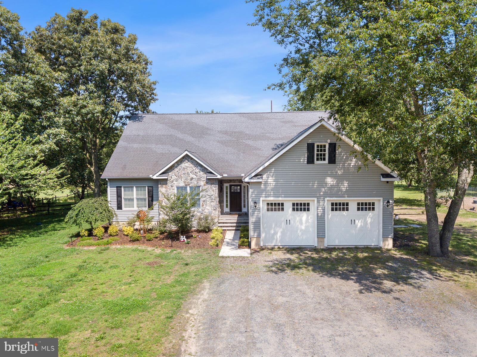 """Welcome to 20887 Johnson Road!   This incredible newer model home has been well cared for by its current owners.   Make your way up the long driveway of this  2 acre property and head inside.  The home has been upgraded with incredible pine 8"""" wide plank hardwood floors, that greet you upon entry.   Inside you will find a modern, open layout, and a huge gourmet kitchen outfitted with newer cabinets and gleaming granite.  The Kitchen also offers a breakfast bar, and plenty of room for a dining table.   The dining area has windows and french doors facing westward, the perfect place to catch sunset.   You may also enjoy this view from your deck, which currently leads to an above ground pool which will be included in the sale of the home.  The Primary suite offers a full bath and walk in closet, with the secondary a tertiary bedrooms just a short walk across the living room.   Upstairs there is a more private suite, complete with a bedroom and full bath.  The Basement is perfect for any buyer looking to add square footage, as nearly all of it has been framed and drywalled.  With a little bit of effort the new owners of this home should be able to add plenty of usable square footage, as the basement has also been outfitted with an egress.  You are invited to tour this home, Schedule your showing, today!"""