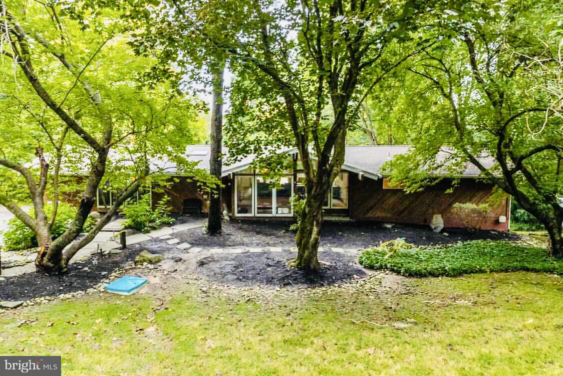 Showings Begin Friday 10/8 @ 1:00pm.  Welcome to this beautiful and rarely offered McElroy Contemporary Home in the award-winning Lower Merion School District with tons of upgrades!  As you enter on the main level you will find a sun-filled living room with vaulted ceilings, open floor plan, mid-century-modern fireplace and glass sliders leading to a large deck with panoramic treetop views that is perfect for entertaining.  The kitchen has gorgeous glass-etched cabinets with tons of storage, an enormous walk-in pantry, granite countertops, brand new refrigerator, and opens up to the breakfast room and family room with another fireplace and built-in bar.  The dining room, along with the entire main floor has floor-to-ceiling windows and sliders to the deck. The First-Floor master suite features hardwood floors, vaulted ceiling with a fan, a third wood-burning fireplace, glass sliders with private deck access, a completely renovated master bathroom with heated floors, large soaking tub, extra-long double vanity stinks and custom-built floor to ceiling cabinets for storage, plus a very large dressing room/walk-in closet.  The lower-level features 3 additional bedrooms, a completely renovated full bathroom with double vanity and steam shower, a walk-out den with views of the pool, laundry room and storage leading to the 2-car garage.  Updates include: newer septic system, whole house generator, new roof and skylights, extensive landscaping, new retaining wall, all newer bathrooms, new garage door openers/tracks/lighting, new stainless steel chimney liner, fence, and so much more!  Inquire with Listing Agent for a full list of updates.  This home has a very private and peaceful setting with gorgeous landscaping and a pool.  This home will not last!  NOTE: put in 1620 Winston into GPS for directions.