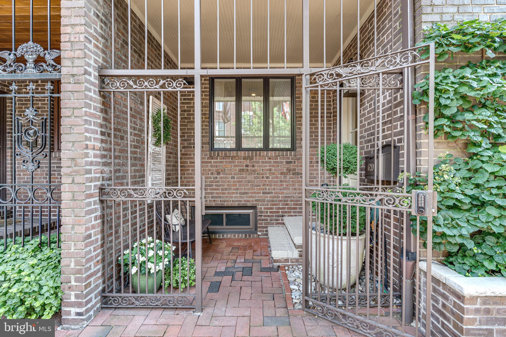 Nestled amongst the lush mature trees and historic red brick sidewalk on one of Society Hill's most idyllic blocks you'll find 620 Pine St. This 3 bedroom, 3.5 bathroom home was meticulously renovated in 2015 with an ideal blend of traditional style and modern features. Not only is this home located in a highly desirable neighborhood, it also offers highly sought-after amenities including multiple outdoor spaces, a 1-car deeded parking spot, office/flex space, and a finished basement. At the front of the home, a gated recessed patio acts as a buffer from the outside world. Inside, you're greeted by a two-story foyer, a coat closet, and a powder room. Beautiful hardwood floors guide you into the stunning Chef's kitchen. Adorned with quartz countertops, a tile backsplash, and custom inset cabinetry enhanced by a panel-covered Sub-Zero refrigerator, a Bosch double range, and Newport brass fixtures, this kitchen looks like it belongs in a design magazine! A massive island with seating for 3+ and built-in speakers adds to the functionality of the space. Past the adjoining dining area, you'll step down into the sun-drenched living room where shiplap walls, brick floors, and a gas fireplace create a warm and inviting space. From the living room, 8' glass French doors open to the secluded back patio. Surrounded by serene foliage, this private oasis is perfect for relaxing on cool spring days and entertaining on warm summer nights. Back inside the home, the large finished basement with tile floors, high ceilings, and recessed lights, could be configured as a den, theater room, gym, or playroom. A separate section of the basement houses the laundry room, mechanical closet, and an area for extra storage. The home's second level is dedicated to the primary suite. The large, carpeted bedroom is framed by crown molding and filled with natural light from an oversized window. The custom walk-in closet is easily configurable to fit your wardrobe needs. The luxurious ensuite bath has