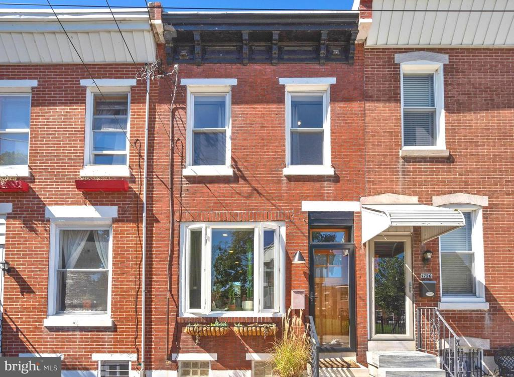 **OPEN HOUSE Saturday 10/9 from 1:00-3:00 PM** Welcome to 1724 Memphis St -- a tastefully updated and lovingly-maintained home in the heart of Fishtown!  The sellers have completed many thoughtful upgrades during their ownership, including the installation of a stunning slat staircase, wood front door, and built-in desk/bookcase -- all custom-made!  (Be sure to see the attached documents for a complete list of upgrades.)  The open concept entry level includes a living/dining area as well as a kitchen with granite countertops, seated peninsula, double bowl sink, & subway tile backsplash.  Exit the kitchen to a spacious back patio (one of two outdoor spaces), which offers plenty of room to garden, grill, or entertain!  Upstairs, you'll find two sunny bedrooms, a laundry closet with stacked washer/dryer, linen storage, and a full bath with tub & privacy window.  The primary bedroom features two closets and built-in shelving; the back bedroom has sliding doors that lead to the second story deck, perfect for relaxing with a cup of coffee or a book!  The unfinished basement is ready for your customization and is currently being used as a storage area and work space.  Throughout the home, you'll appreciate the abundance of natural light, hardwood flooring, recessed lighting, ceiling fans, and more.  Last but not least, the location is amazing -- situated on a great block in Fishtown, within close walking distance to Frankford Ave favs like Suraya & Cheu; super close to Palmer park, dog park, & playgrounds; also convenient to highways and public transportation (Berks stop on the El) for an easy commute in, out, and around the city.  Don't wait, schedule a showing today!