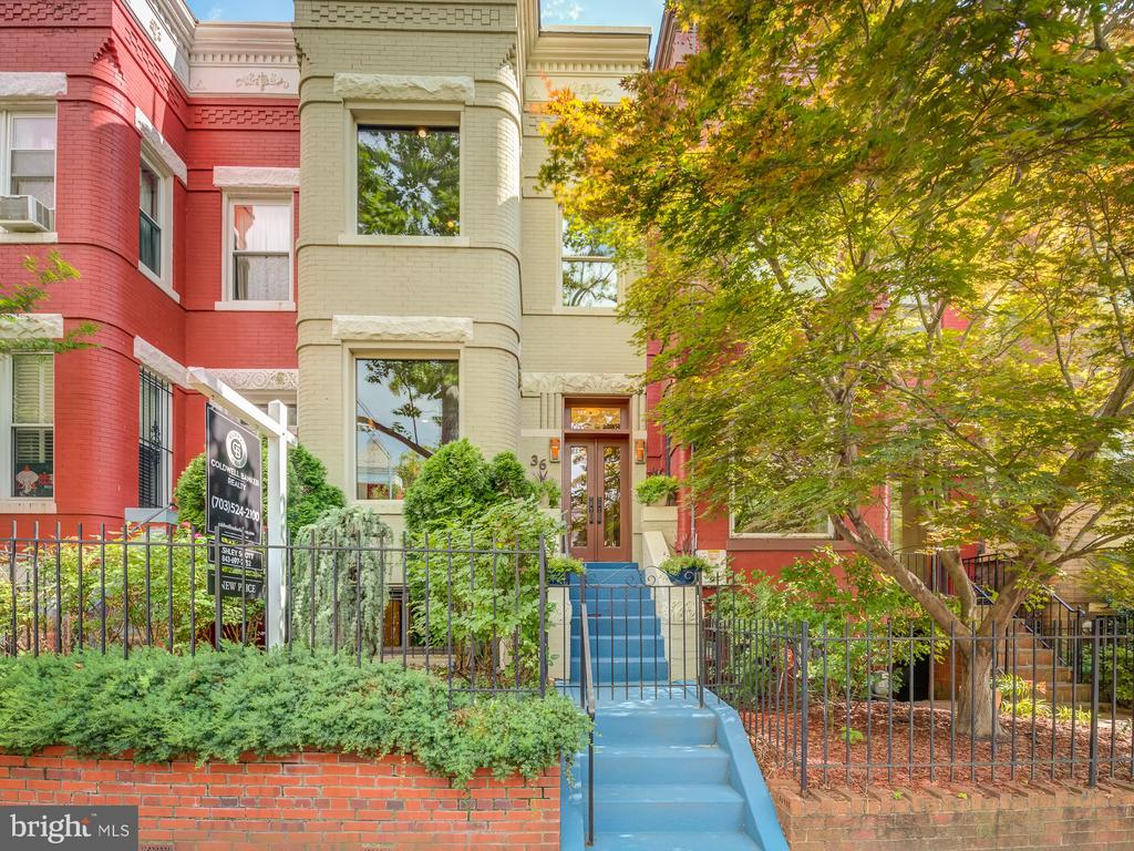 OPEN HOUSE: Saturday, June 19th - 11:00 am - 3:00 pm  **BACK ON THE MARKET WITH NEW PRICE **  Step inside this historic 1895 row home with modern features like elegant crown molding, exposed brick and 10-ft ceilings. This spacious home has over 2,600 square feet of living space with 4 bedrooms and 3.5 baths.  As you enter this light filled home with solid oakwood floors you can see yourself relaxing in front of the wood burning fireplace curled up in a comfy chair with your favorite book pulled from the expansive custom built-ins.  Entertain friends in this expansive kitchen featuring soapstone countertops, high end appliances (Liebherr refrigerator and wine cabinet and industrial grade Thermador gas range) and an eat-in kitchen nook. Grab a bottle of wine from the wine cabinet and relax in your private outdoor space with retractable awning to keep cool from the DC summer heat.  Wind down after a long day in the luxurious owner's suite equipped with a window seating area surrounded by oversized windows that overlook the street's sycamore trees. The owner's suite features his and her closets, en suite bath with radiant flooring, large soaker tub, separate steam shower, toilet room with bidet, double vanity sinks and towel warmer.  Down the hall two secondary bedrooms and a full bathroom complete the second level.  The lower level features a 4th bedroom (or in-law suite) that includes a lounge area, a custom built-in desk convenient for a home office, a large laundry room and full bathroom.  This home is equipped with a high velocity heating/cooling system, tankless water heater, water softener,  reverse osmosis water filter, AND 12x14 walk-in level storage space. Additional amenities include easy access to BFM (the Bloomingdale Farmer's Market), Big Bear Cafe, Red Hen, Creative Grounds DC and The Pub & The People.  Taking metro is a breeze, the Shaw (Green/Yellow) & NOMA (Red) metro stations are less than 10 minutes by foot. Note: Sq ft estimated based on professiona