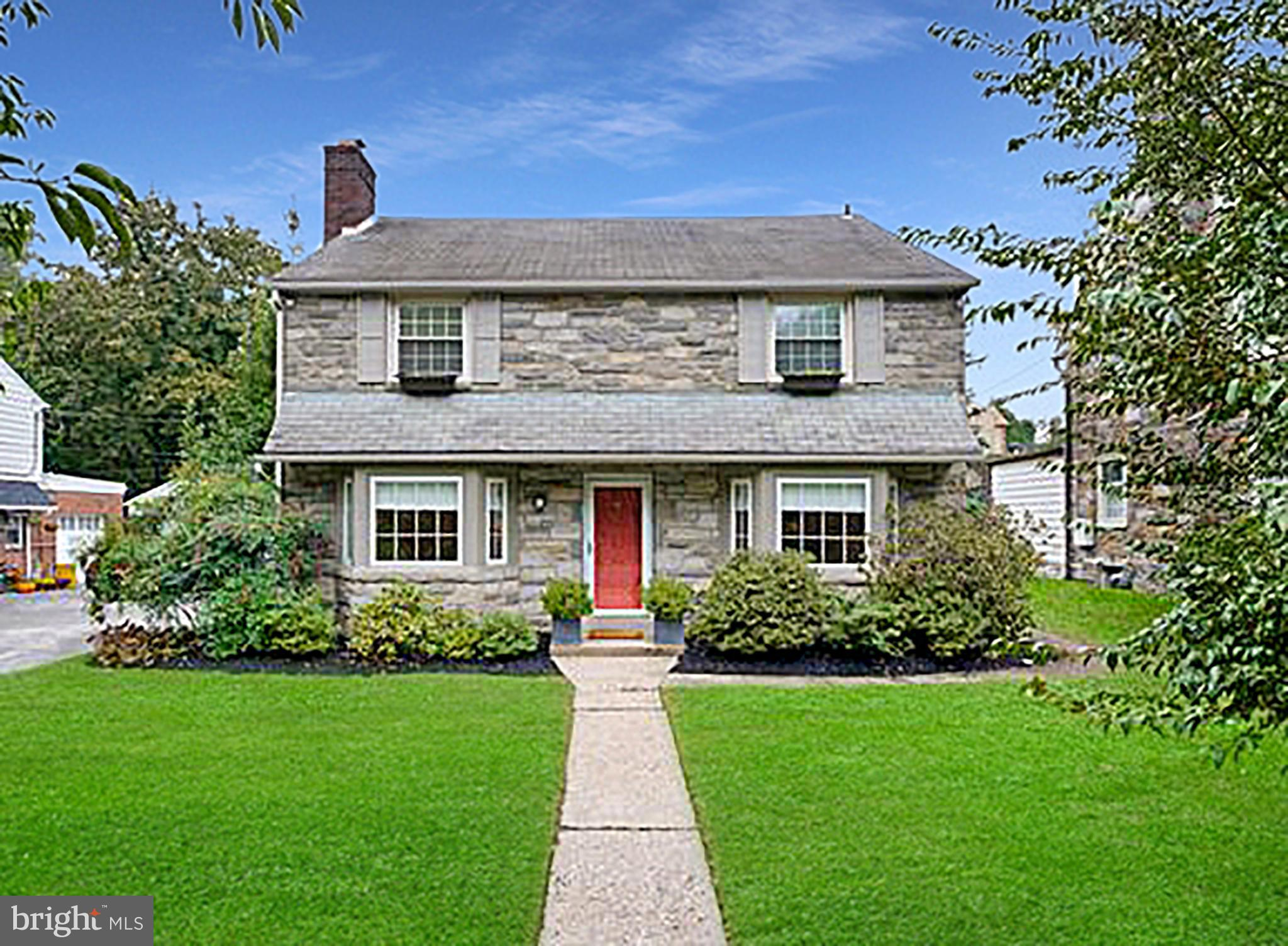 This move-in ready Stone and Brick, Center-hall Colonial is filled with classic features that give it a timeless charm. With 4 bedrooms, 2.5 baths, a beautiful eat-in kitchen, tons of living space, and large, flat rear yard, 28 Overbrook Parkway offers a traditional yet comfortable layout with tons of updated spaces for you and your family to enjoy.   To the left of the entrance is a spacious living room with a wood burning fireplace and hardwood floors. To the right of the entrance you will find a formal dining room with elegant crown and chair rail moldings and a large bay window that lets in a lot of natural light. From the dining room you have easy access to the fully renovated and expanded eat-in kitchen with all white cabinets, state-of-the-art stainless steel appliances, and a charming breakfast nook for you to start your day. The kitchen opens to the family room with custom built-ins and access to the driveway and attached one car garage. A powder room rounds off the first floor.   Upstairs you have the primary bedroom which has a large closet and its own private bathroom. There are also three other bedrooms and a shared hall bath, plus built-in cabinets on the second floor landing that provide tons of convenient storage space.   The finished lower level has enough room for a second family room, exercise room, or whatever fits your familys needs, and even more storage space.    Outside you will also find an ample brick patio and a large, flat, and private backyard with enough room to run around with the kids. All this near award-winning Lower Merion Schools, including an elementary school within walking distance.