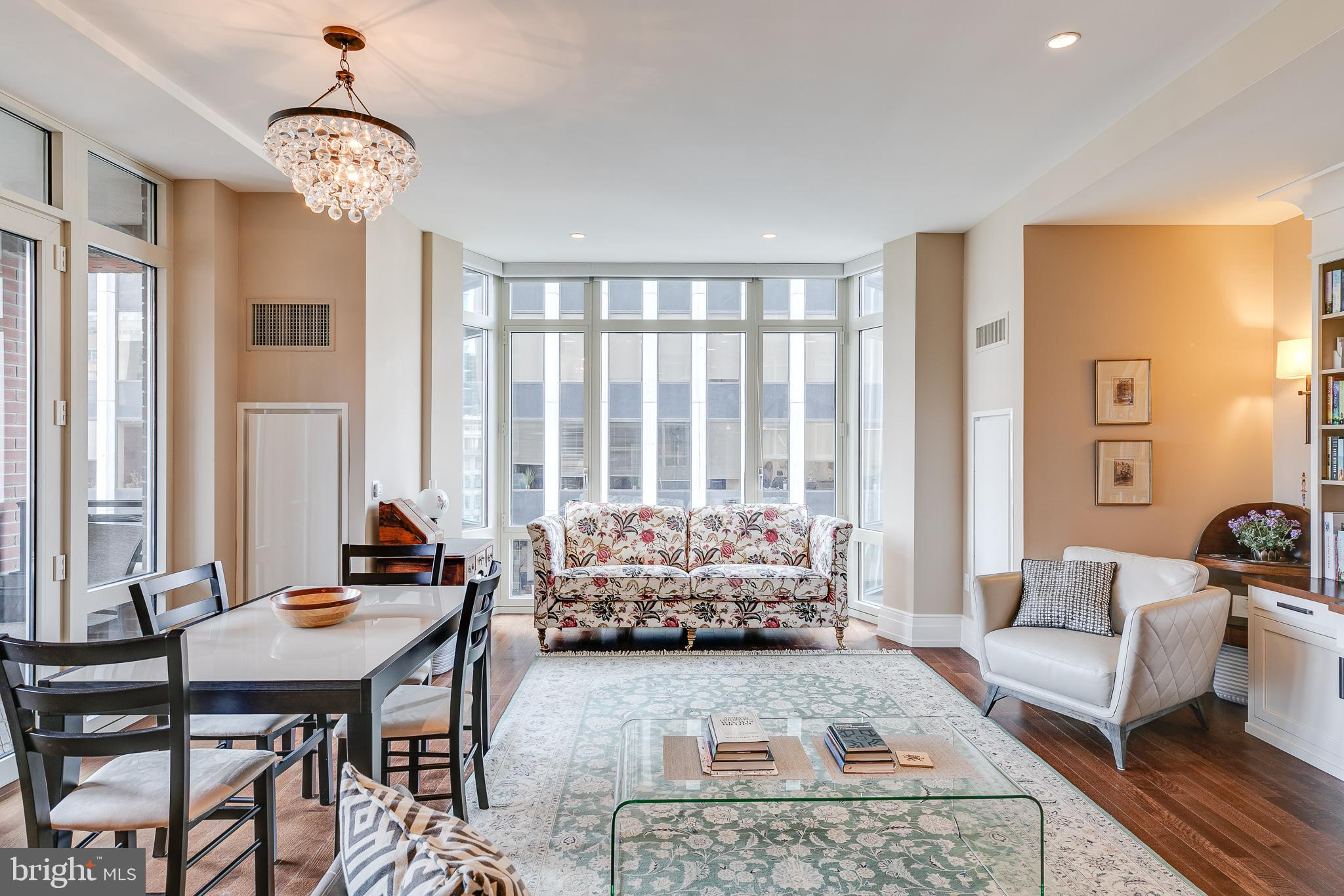 The height of Rittenhouse Luxury in one of the  neighborhood's most handsome more recent builds- this 2 bed, 2.5 bath unit overlooking the square is a quiet and comfortable retreat above town!  Enter the elegant lobby from an intimate courtyard off of 18th street at the square, and head to floor 10. Unit 1005 opens into a foyer lined with large coat and linen closets, and door to half bath. Turn right into the elegantly outfitted kitchen, with stone counters, glass panel backsplash, and stainless appliance suite, including SubZero refrigerator. A large central island provides excellent space for dining or a workspace for the chef as they look beyond into the open living/dining room. The sun-filled living/dining features a floor-to-ceiling bay window on axis, with stately built-in desk/shelving on the north wall and balcony entrance on the south. Head out to the zen brick and wood balcony, privately nestled several floors above Rittenhouse Square treetops. Head back inside to the end of the entry foyer, where you'll find the primary bedroom. This, large, bright south facing room also overlooks the park, and offers twin walk-in closets. The en-suite bath is fitted with an oversized standing shower, separate soaking tub, and dual vanity. Across the living room is the second bedroom, with large closet, floor-to-ceiling window nook, and en-suite with oversized shower. Beyond your unit, enjoy the many amenities of 10 Rittenhouse including an amenity floor, outdoor gardens/terrace, guest suite, catering kitchen/event room, library, temperature controlled wine storage, designated item storage, fitness center, and pool/spa. Transportation about town is a breeze with a chauffeured BMW 740i town car, bike storage/maintenance area, and valet parking. You're steps away from SEPTA's many in-town bus lines, and a few blocks from the Broad Street Subway and Market Street Subway-Surface Trolley. Enjoy fabulous meals in and around Rittenhouse Square including Parc, Barclay Prime, The