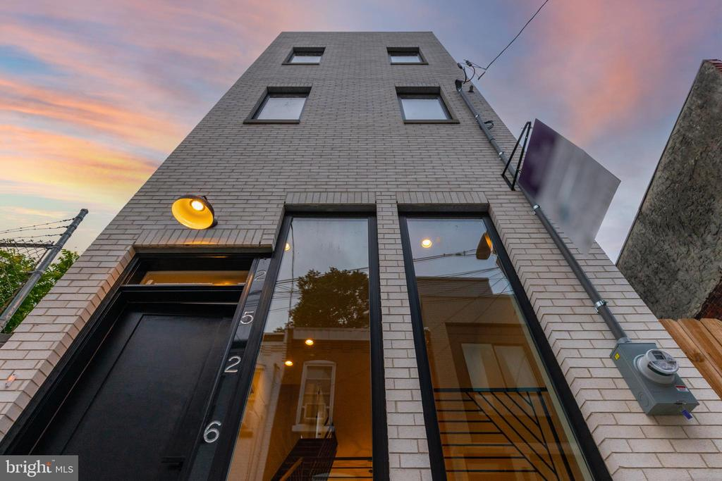 Welcome to 2526 E Gordon Street - A truly unique 3 BR/2.5 BA single detached contemporary city house tucked down a quiet cobblestone side street yet just a short walk to everything that bustling Fishtown has to offer.  Enter into a 2-story foyer and ascend open-riser stairs to your main living floor with wide plank light oak floors and flooded with natural light giving this house a loft-like feel.  A chef's eat-in kitchen with contemporary European-style flat panel cabinets, stainless appliances, white quartz counters and island ideal for daily dining or entertaining.  Dining plus living area.  Access to the enclosed rear patio perfect for outdoor grilling.  Upstairs are 2 great-sized guest rooms plus a tasteful and timeless hall bathroom.  Your third floor is the Primary Suite oasis complete with a large bedroom and a fabulous spa-like en-suite bathroom with step-in shower with frameless glass doors, custom double vanity.  Large finished lower level with a powder room and laundry room with side-by-side washer/dryer is great additional living space for a family room, home office, gym, guest quarters or all of the above!  Rooftop deck with explosive Center City skyline, bridge and sunset views.  With a floor plan and finishes inspired by European lifestyle, a white brick facade and contemporary black Andersen windows this is a truly unique city house in a great location.  Easy access to transportation, Center City, major highways and the suburbs.  10 year property tax abatement.
