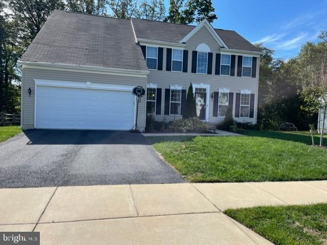 Located in the desirable Townsend Village II Community and in the Appoquinimink school district, this well maintained 4 Bedroom 2.5 home sits on a premium lot that backs to the woods. Some features include a two story entry hall way, turned staircase and hardwood (Vinyl pranks)  floors through out the entire first floor. Upstairs you will find a huge Main bedroom with 2 large walk-in closets and another 3 spacious bedrooms. The basement is finished but also leaving a huge storage space and rough-in for a future bathroom. There is an extra closet in the basement for seasonal clothes. The property also has gutter guards through out. Come see this one today and you won't be disappointed, there is pride of ownership through out this home.