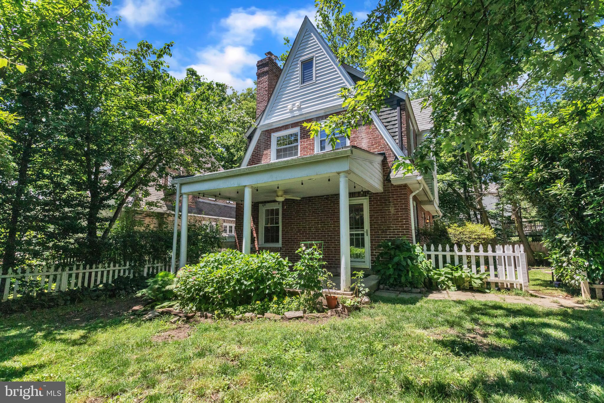 Welcome to this charming 1920s Tudor cottage in the coveted Borough of Narberth. A covered porch offers a relaxing outdoor sitting area and overlooks a level backyard enclosed by a white picket fence. Inside, the first floor consists of a spacious living room, complete with a wood-burning fireplace, a sunny kitchen, and dining room. Up the winding, oak staircase, you'll find a nicely sized primary bedroom with a half-bath ensuite equipped with stackable washer and dryer. Two more bedrooms and a full bath complete this level. Each bedroom is bright and sunny with large closets. Beautiful old-growth oak hardwood floors flow throughout the entire home. A scenic, 10-minute stroll takes you into the heart of downtown Narberth, which boasts boutique shops, neighborhood eateries, and beautiful parks. Hop onto the train at Narberth station, and in 15 minutes you're in Center City, or a quick 5 minutes in the opposite direction, you're at Ardmore's Suburban Square shopping district. Upgrades include brand new natural gas boiler (Dec 2020), new flue liner for gas water heater and boiler (Jan 2021), and completely upgraded electric panel and wiring. Don't wait on this Narberth gem. This house will not last long on the market!