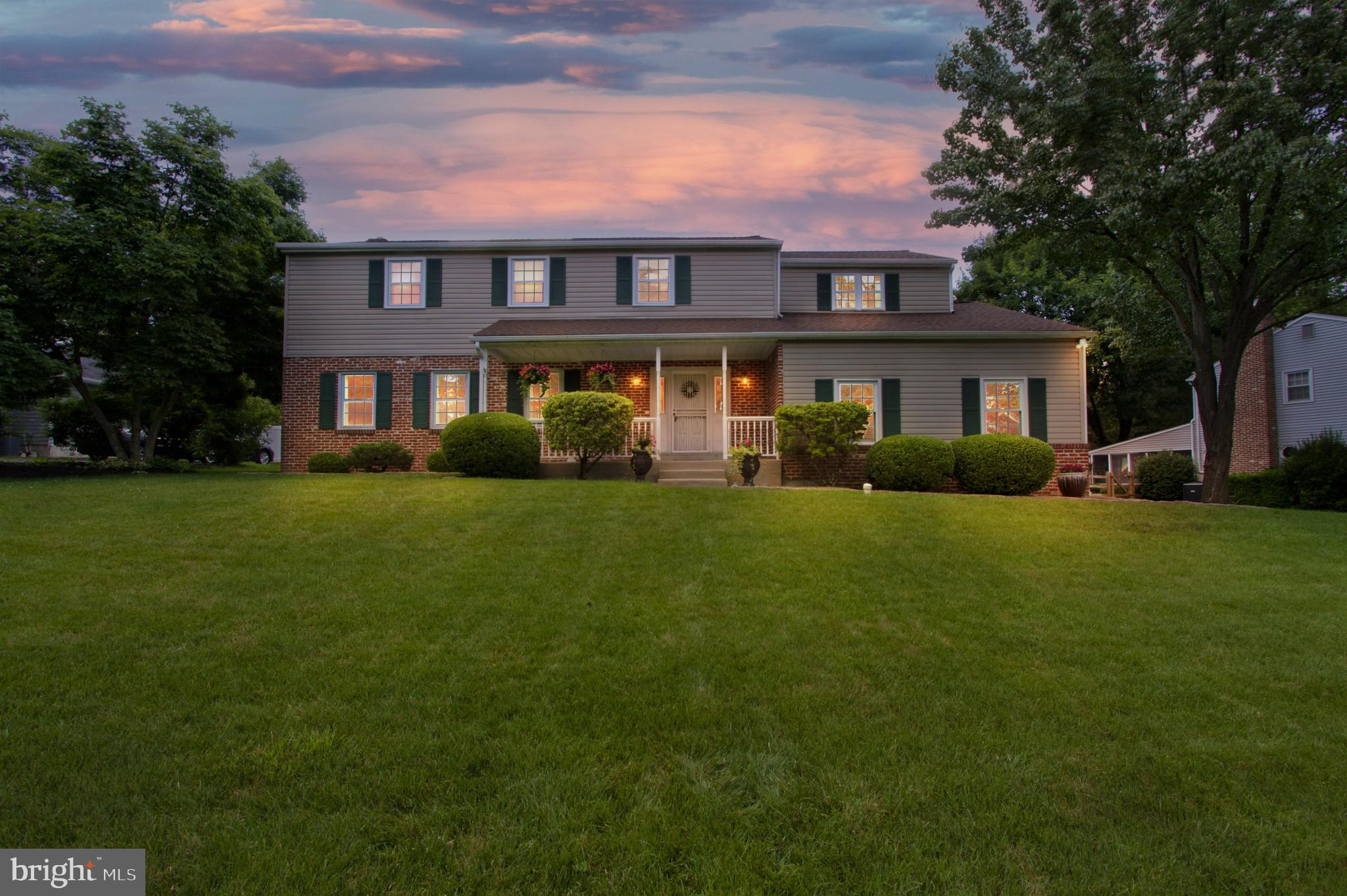 Welcome to this amazing 4-bedroom, 3-bathroom home in West Chester! This wonderful home spans 3,718 sq ft (including a partially finished basement) and is full of ample storage space and well-appointed features throughout. Enter through the front door (which is heavy duty providing great security) directly into the large foyer which includes an abundance of closet and storage space! The main level of the home features beautiful hardwood flooring and crown molding throughout. To the left, there is a spacious living room with 2 large windows to let in lots of great natural light! The huge dining room includes a gorgeous gas-burning fireplace with mantel surrounded by lots of built-in shelving and cabinets lining the entire wall. The large, open kitchen boasts modern stainless steel appliances, Corian countertops, a central island with quartz countertop, a built-in pantry, and decorative tilework above the stove. There is even a spacious eating area right off of the kitchen! The bright and sunny family room is incredibly large, with high vaulted ceilings, plush wall-to-wall carpeting, recessed lighting, and ceiling fan. Rounding out the main level of the home is a laundry room and convenient half bath. Heading upstairs, you will find 2 primary bedrooms as well as 2 additional bedrooms (3 bedrooms have ceiling fans and all have abundant closet space!). The first primary bedroom features two walk-in closets and ensuite bathroom with large double vanity, beautiful tile backsplash, and glass-enclosed stall shower. The second primary bedroom also includes an ensuite bathroom with stall shower. Completing the upper level is an additional full bathroom off of the hallway with tub/shower combo. The lower level of the home is fantastic with plenty of space for indoor recreation! The unfinished side of the basement contains lots of great built-in shelving for convenient storage, and there is a crawl space for storage as well. Rounding out the lower level is another convenient ha