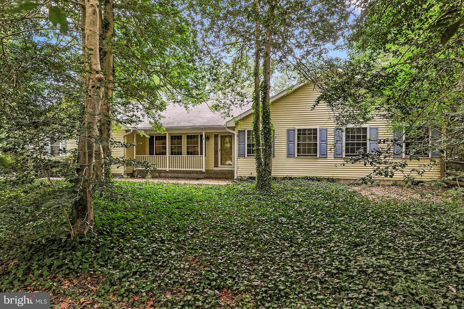 Beautifully secluded 3 bed/ 3 bath ranch home in established and desirable South Shores community! Nestled in a wooded cul-de-sac, this is where you want to rest and relax... Large, wraparound deck with awning in the fenced-in rear yard for added privacy. Inside, you'll enjoy the surprising space offered throughout the home - with 3 large bedrooms, including a primary bedroom with HIS AND HER BATHS and walk-in closet!! Leased solar panels with two bonus solar lights (one in the kitchen and one in the first bath in the primary bedroom) and geothermal heating make this an environmentally friendly and cost efficient home! New floors in living room, large primary bedroom with en suite and spacious kitchen are just a few of the things you'll love about this house!