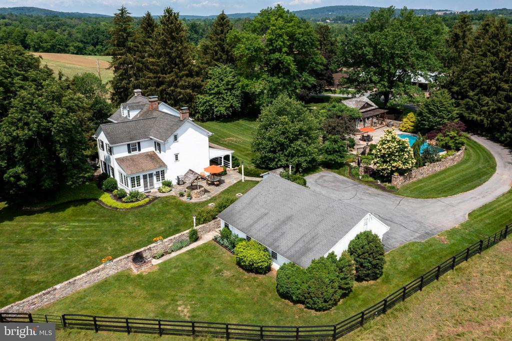 """Very rarely does a bucolic working farm, like West Winds Farm, become available for sale in Chester County.  The Property consists of 53 acres, mostly gently sloping pasture lands, a main home, a tenant home, 3 barns, a 1 acre pond and a pool retreat with live in pool house.  The Main Home, originally built in the 1780's, has several well blended additions, the first constructed in the 1940's fully renovated in the 1960's and received an extensive Peter Zimmerman designed addition in 1999 with a sun soaked kitchen, modern amenities, hardwood flooring throughout, extensive granite counterspace, center island downdraft cooktop, wonderful pond view and easy access to outdoor features including terrace, patio and entry breezeway.  The first floor also offers an office with built-ins, dining room with easy kitchen access. a half bath and a """"Spa-hot-tub"""" room.  The home offers two fireplaces, one gas and one wood-burn stove.  The second floor  offers a primary bedroom suite with sitting room, walk in closet, dressing area with coffee bar, full bath with double vanity and oversized shower. The second floor also has 2 nicely sized bedrooms and full hall bath. The spacious pool retreat has fire pit, waterfall, outside shower and a fully equipped pool house with vaulted ceilings, gas fireplace, king size Murphy bed, built-ins, half bath and gourmet kitchen!  The tenant home was reconstructed in 2001, is a tenants delight, easily rented and income generating.  Both homes are supported by 3 car detached garages.  Property is in both ACT 319 (enjoy discounted taxes) and the Chester County Ag Preservation Program which allows only one future subdivision which must remain in agricultural use (does not need to be animals).  The property is closely associated with French Creek, a PA designated exceptional water quality stream, and consequently the USDA has invested in controlling barnyard rainwater runoff and a state of the art manure management system.   Additional information upon"""