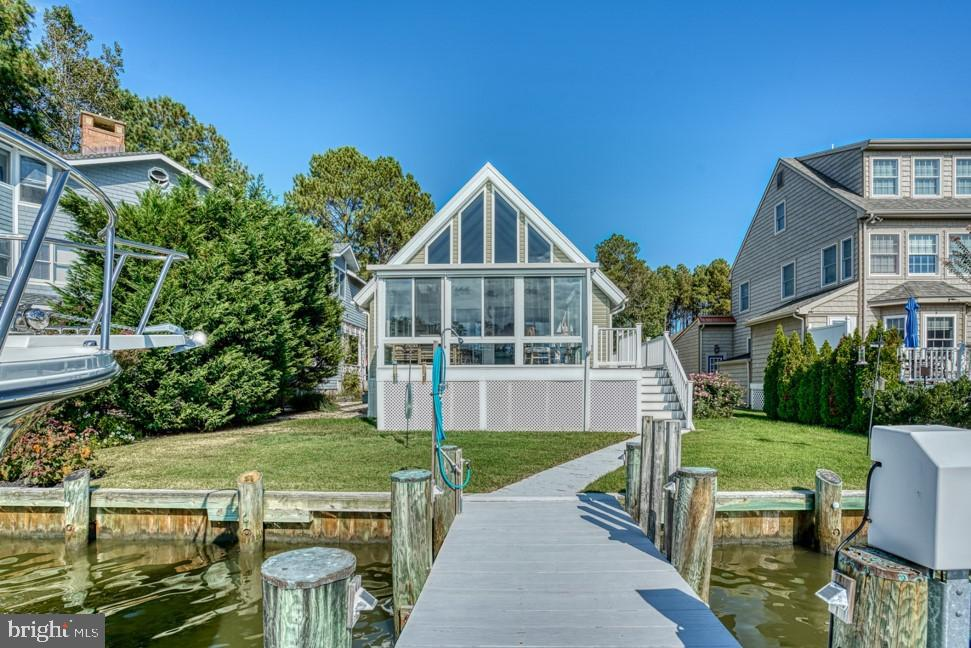 Truly Breathtaking Views of EXTRA DEEP canal that boasts a boat lift,2 pwc lifts and a fishing dock with Ladder. This Charming 3 bedroom 2 full bath has recently had a NEW roof,Trex deck and giant sunroom with electric shades. New flooring in Entire home!! Newly painted! With workshop/garage!