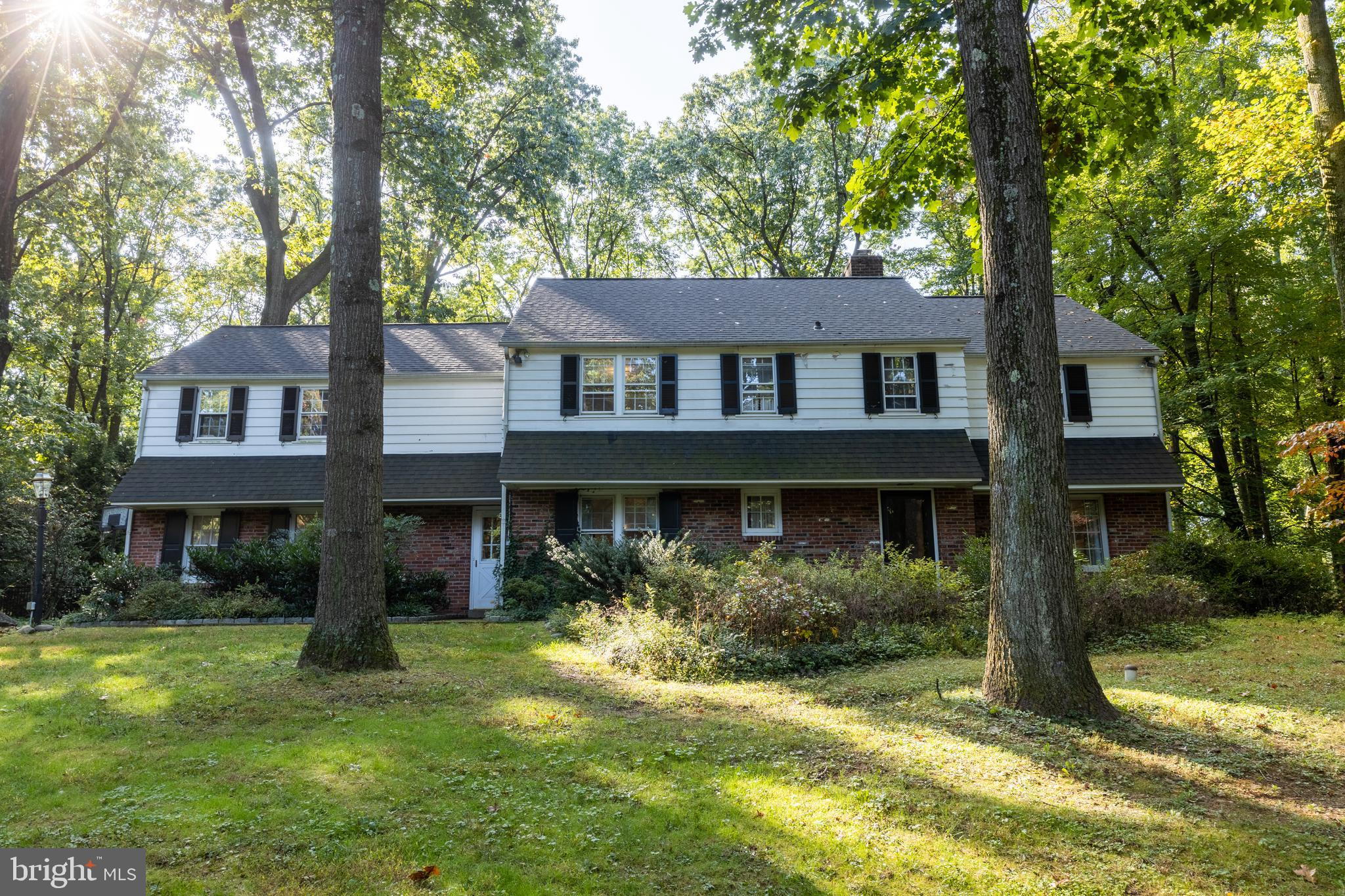 Perched on a sprawling corner lot in sought-after Radnor Township, this classic center-hall brick colonial offers endless potential for buyers eager to customize. The expansive first floor features hardwood floors throughout, abundant natural light and ample space for entertaining and relaxation. Just off the bright and airy foyer sits a spacious living room with fireplace and French doors leading to the large back patio. The living room connects to a cozy home office with custom built-ins and beautiful backyard views. On the opposite side of the first floor, you'll find a sunny eat-in kitchen with plentiful cabinetry and counter space, plus a window wall atop a double sink. For maximum convenience, the kitchen also boasts direct access to the attached garage. A powder room and generously sized dining room with chair rail completes this traditional first floor. Hardwood floors continue throughout the upstairs level, which features five well-sized bedrooms, three full bathrooms, plenty of closet space and a rear stairway leading directly to the kitchen. The second floor also includes closeted access to an unfinished attic that could be converted to a bonus room, home gym or play space. The finished lower-level features floor-to-ceiling built-ins and a large laundry room with utility sink. The fenced-in backyard is complete with brick patio framed by a pergola and an in-ground pool, perfect for lazy summer days. Homes on this friendly, tree lined street are zoned for nationally ranked Radnor Township School District. Offering plenty of privacy plus easy access to major roadways, downtown Wayne and other Main Line hot spots, this home is ready for your vision and personal touch. Please note, any needed repairs are included in list price. This house needs some TLC, which is reflected in the price.  This is a great opportunity for you to purchase a good home and make changes for a good value. Please note that Delaware County is conducting a real estate tax assessment eff